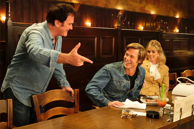 "Director Quentin Tarantino (left) with Brad Pitt on the set of ""Once Upon a Time in Hollywood."""
