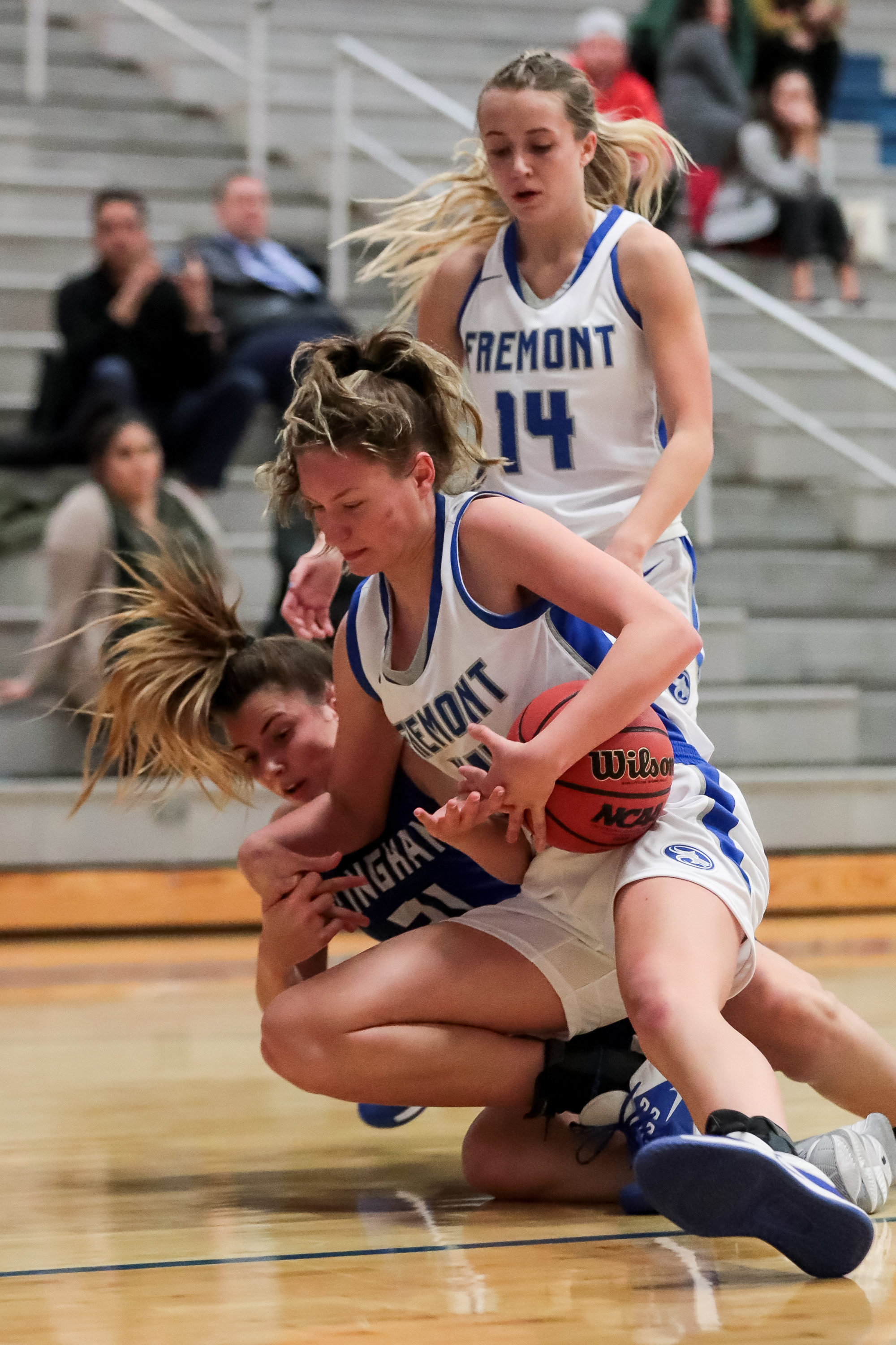 Fremont's Maggie Mendelson and Bingham's Chloe Daniels fall as they vie for control of the ball during a high school girls basketball game at Fremont High School in Plain City on Tuesday, Dec. 3, 2019.
