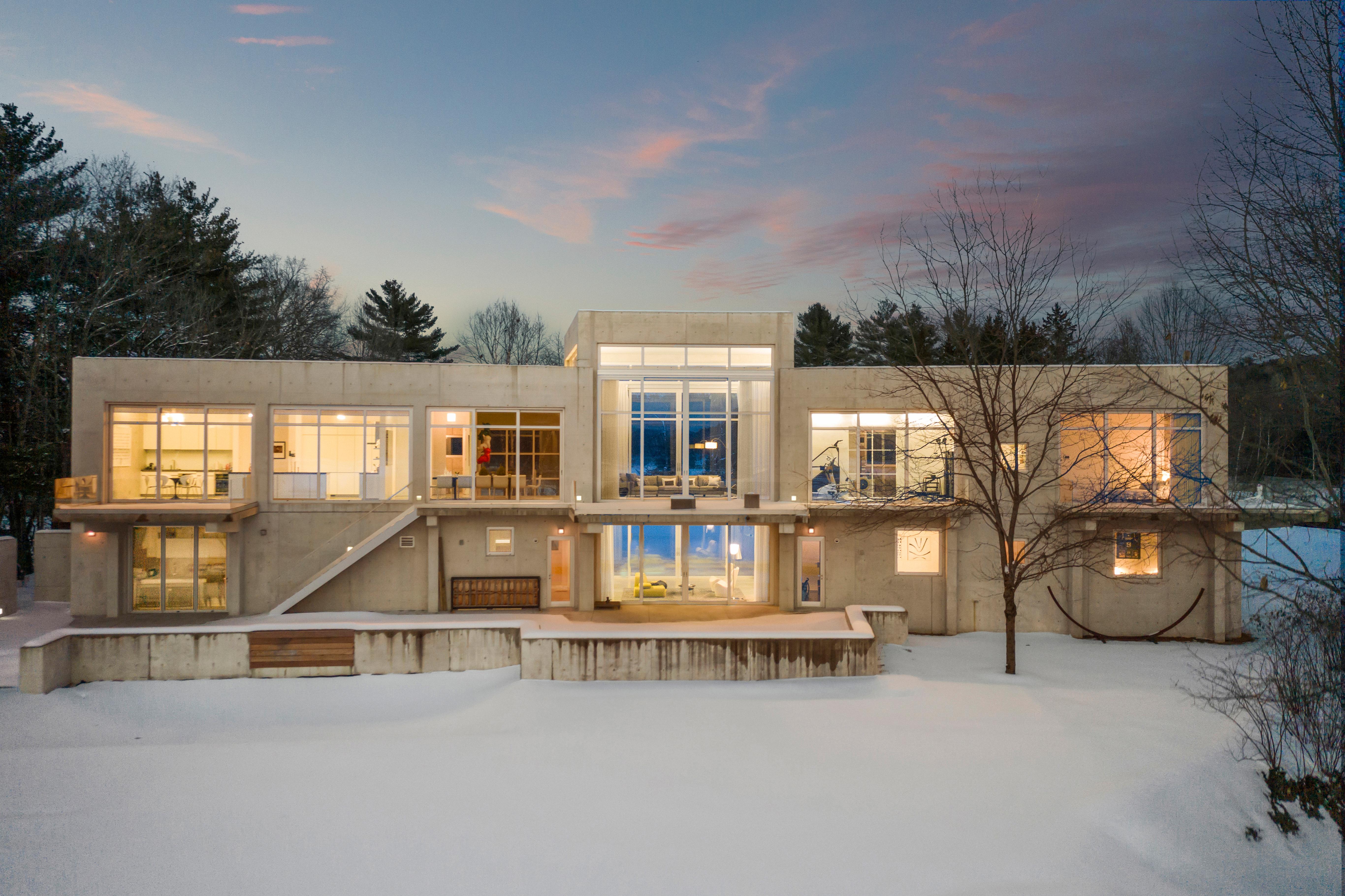 All-concrete riverfront home asks $4.7M