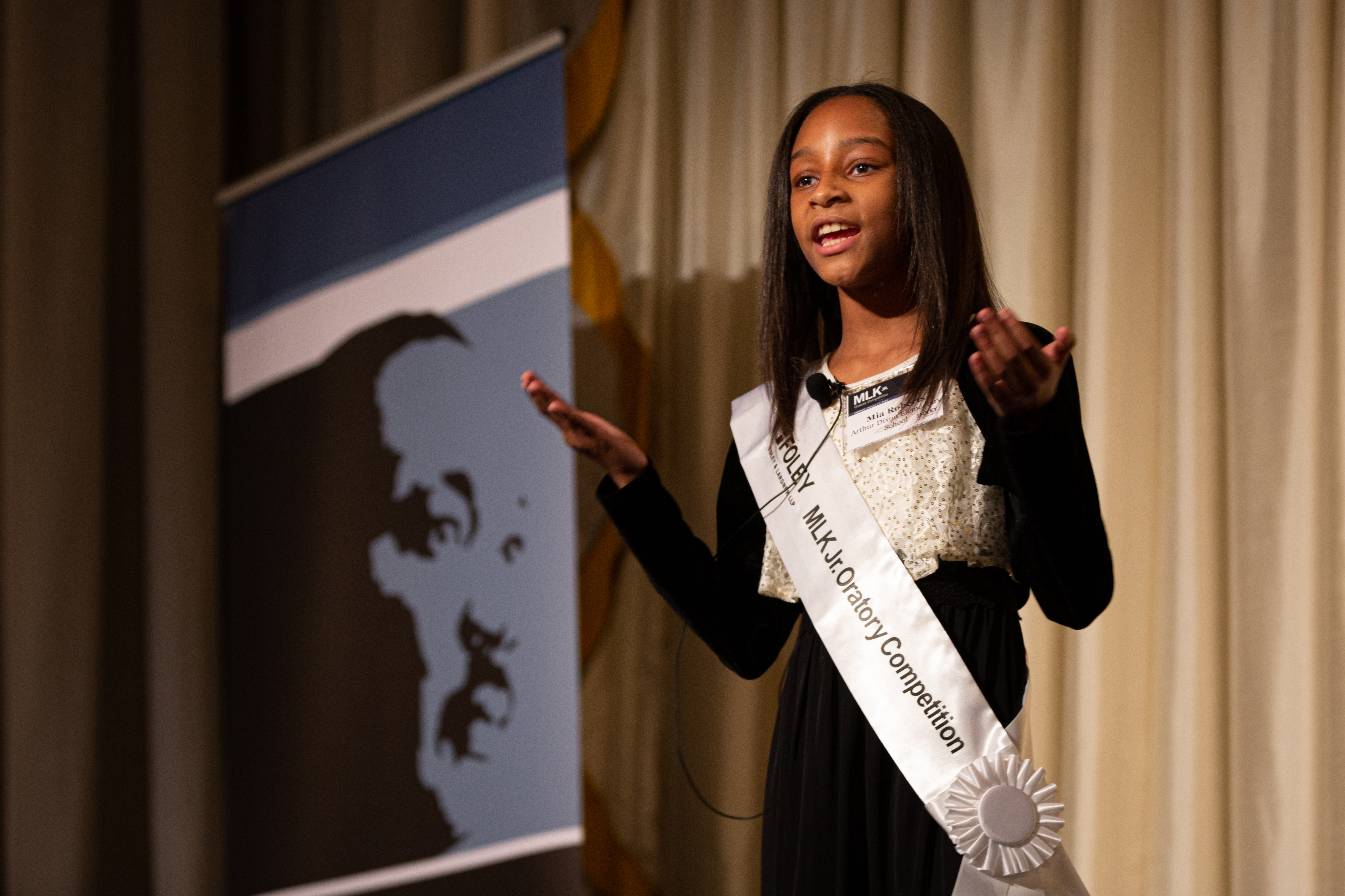 Mia Roberts, 9, a student from Arthur Dixon Elementary, speaks to the audience Friday during a Martin Luther King Jr. oratory competition at The Palmer House Hotel.