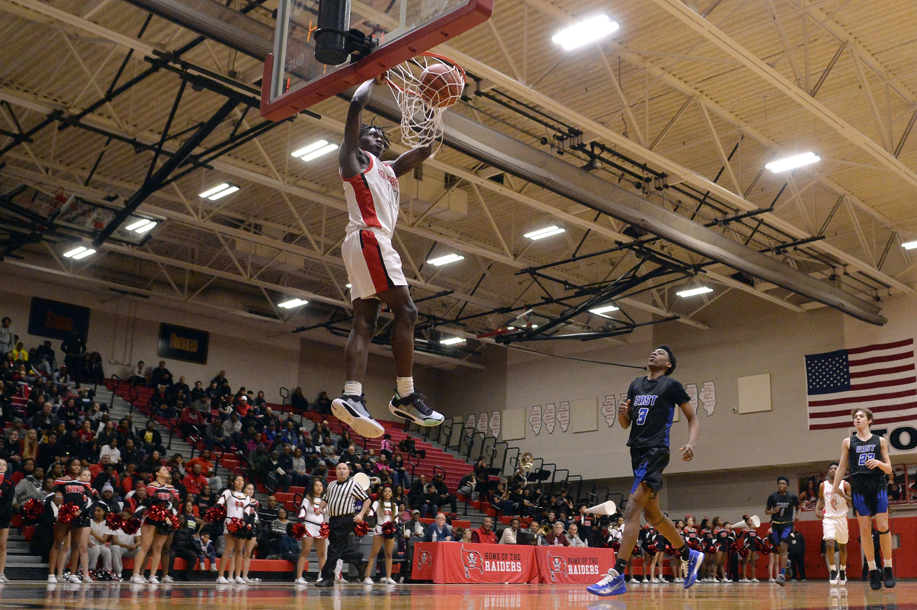 Bolingbrook guard Darius Burford (10) dunks the basketball in the first half of the game against Lincoln-Way East.
