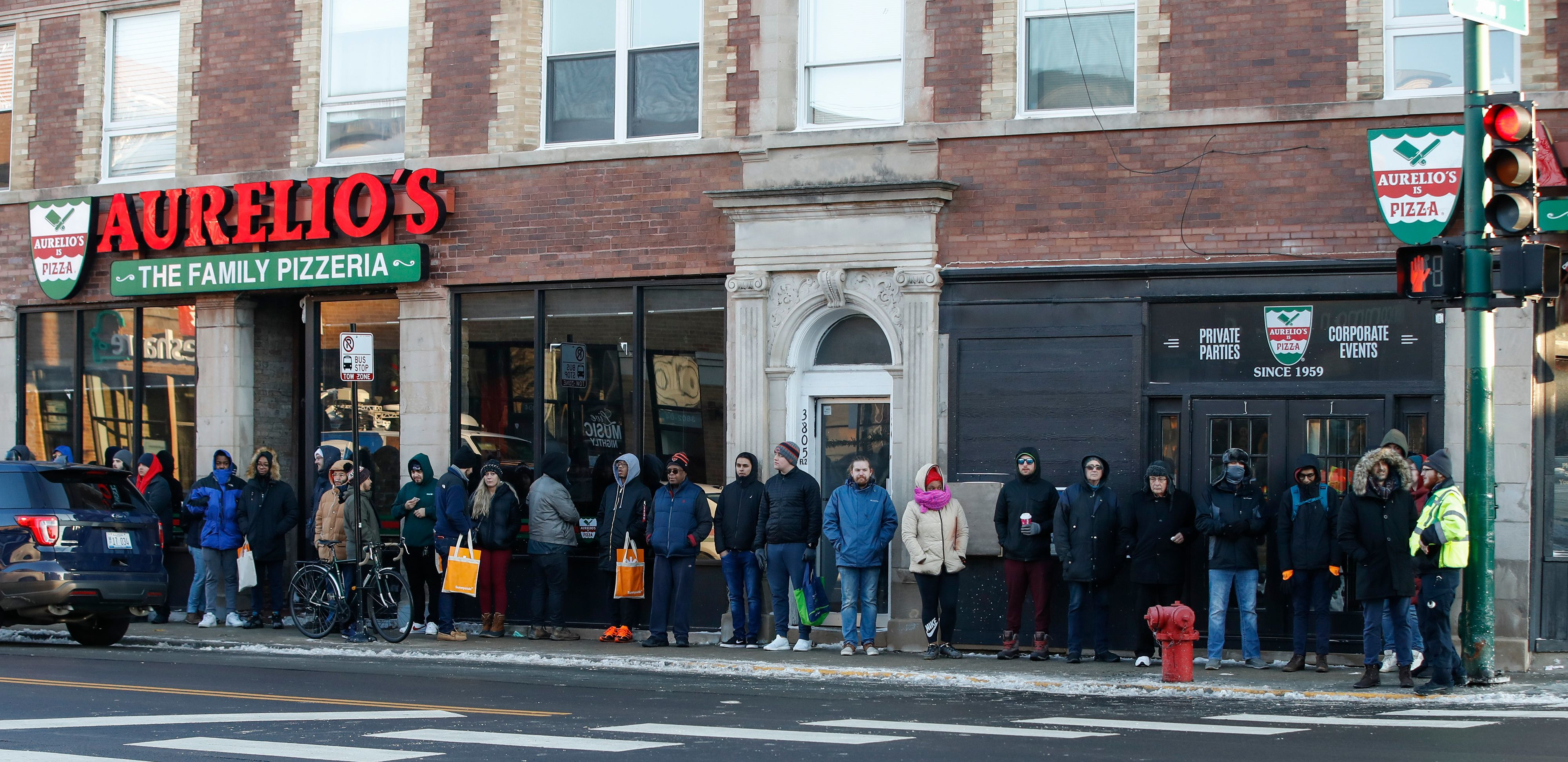 On January 1, 2020 customers wait in line outside Sunnyside Cannabis Dispensary to purchase recreational marijuana.