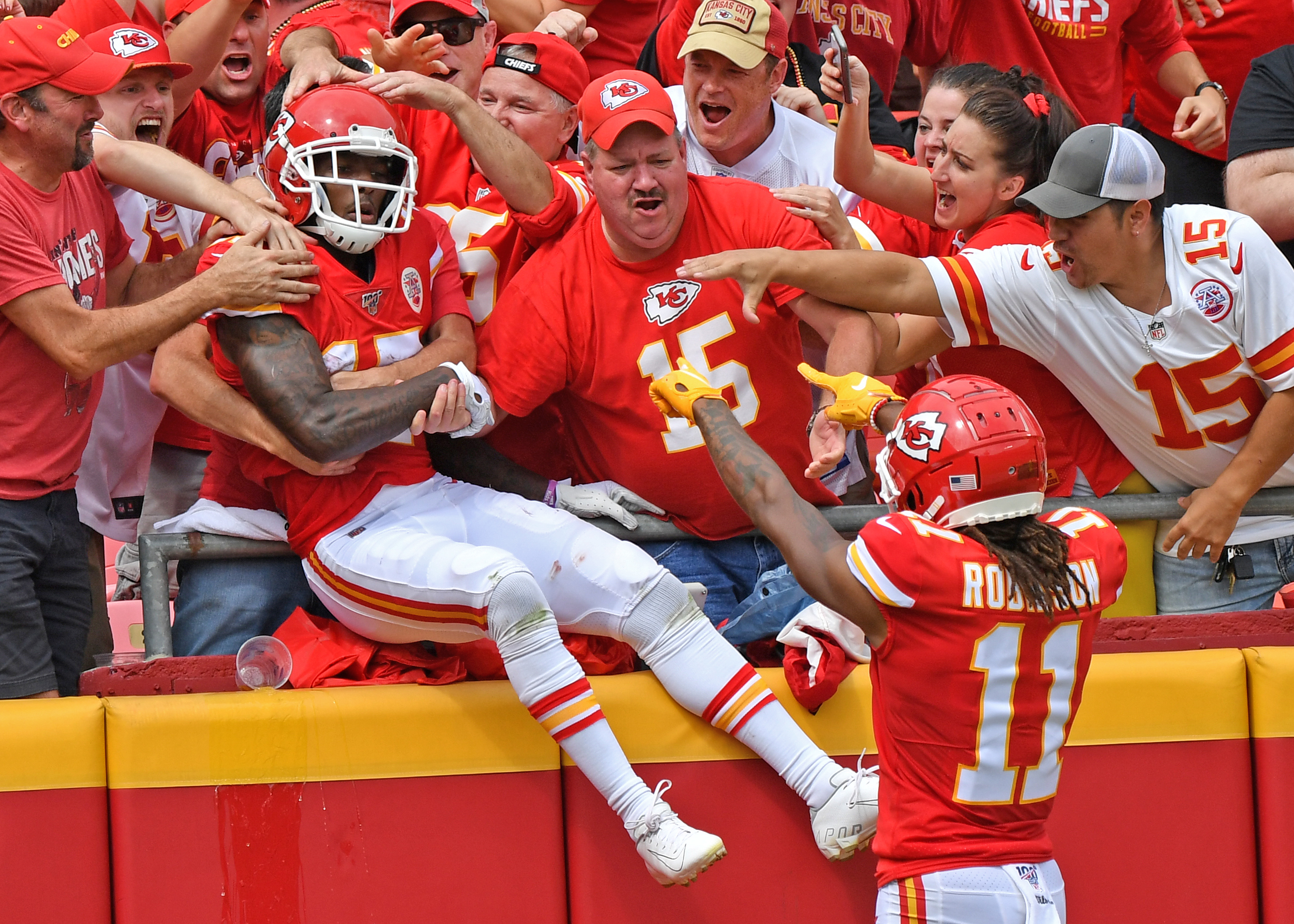 Wide receiver Mecole Hardman #17 of the Kansas City Chiefs leaps into the stands after scoring a touchdown against the Baltimore Ravens during the first half at Arrowhead Stadium on September 22, 2019 in Kansas City, Missouri.