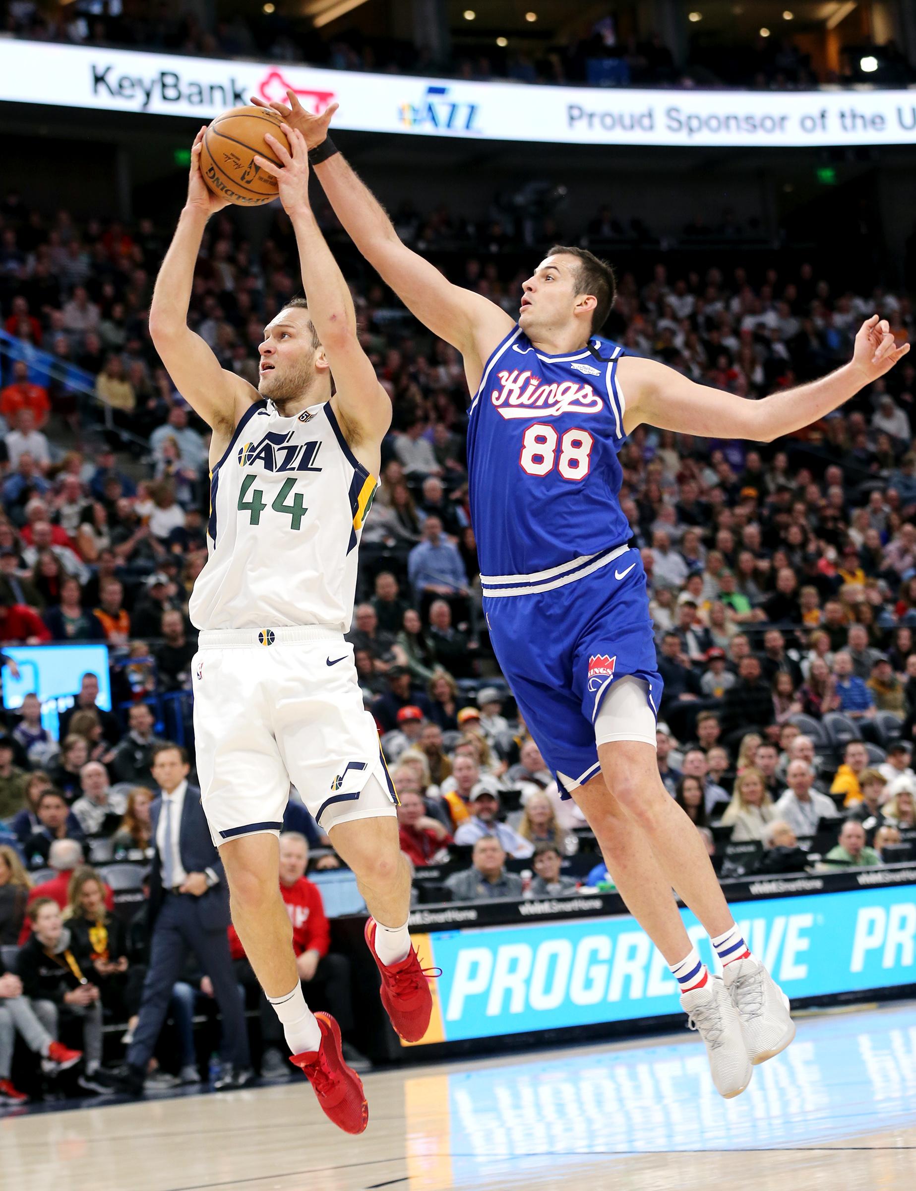 Utah Jazz forward Bojan Bogdanovic (44) goes up for a shot with Sacramento Kings forward Nemanja Bjelica (88) defending as the Utah Jazz and the Sacramento Kings play an NBA basketball game at Vivint Smart Home Arena in Salt Lake City on Saturday, Jan. 18, 2020.