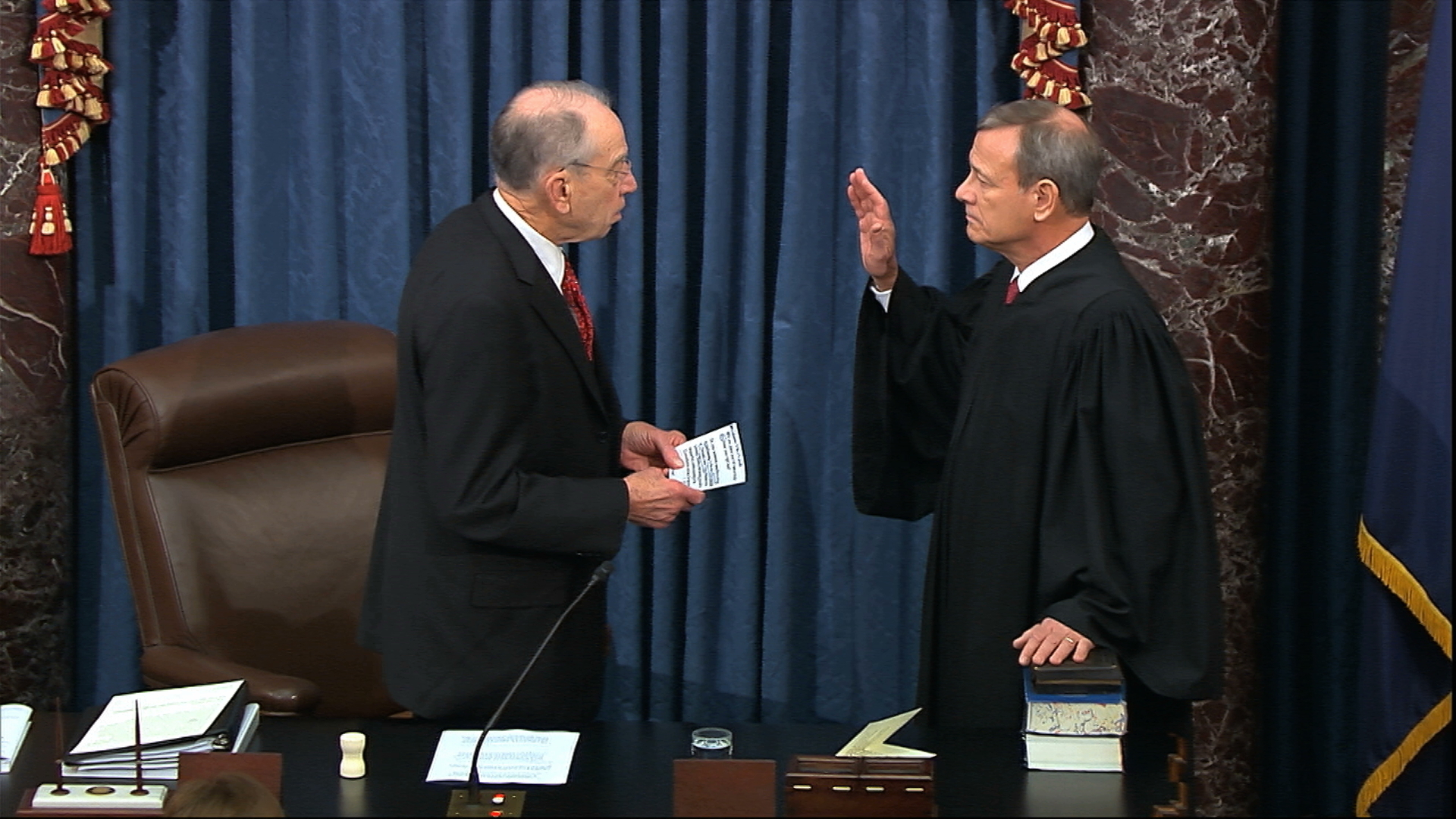 President Pro Tempore of the Senate Sen. Chuck Grassley, R-Iowa., swears in Supreme Court Chief Justice John Roberts as the presiding officer for the impeachment trial of President Donald Trump