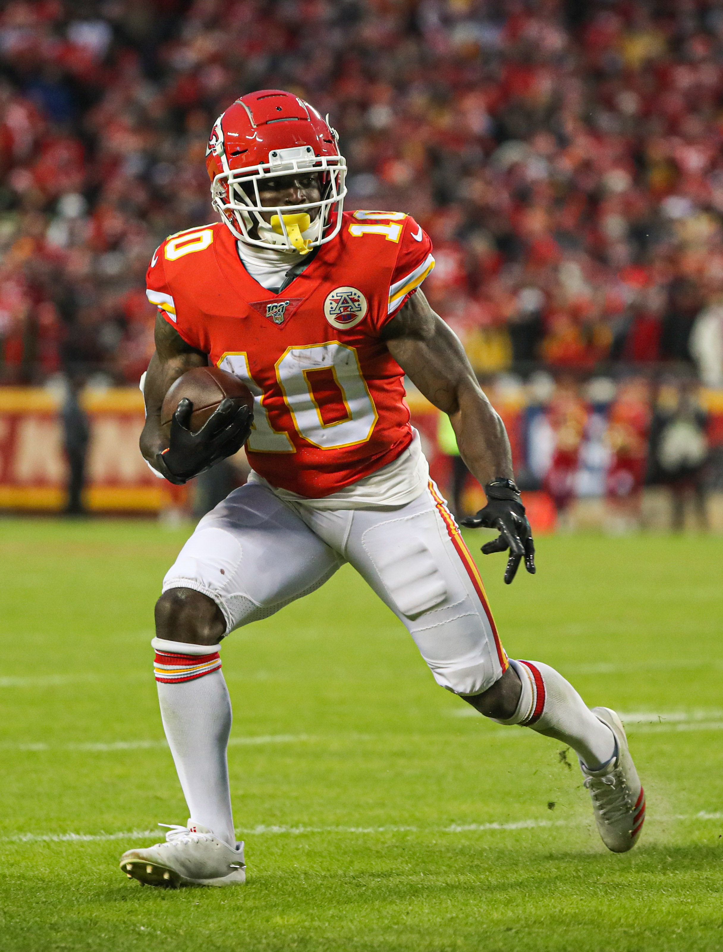Kansas City Chiefs wide receiver Tyreek Hill runs against the Houston Texans during the second half in a AFC Divisional Round playoff football game at Arrowhead Stadium.