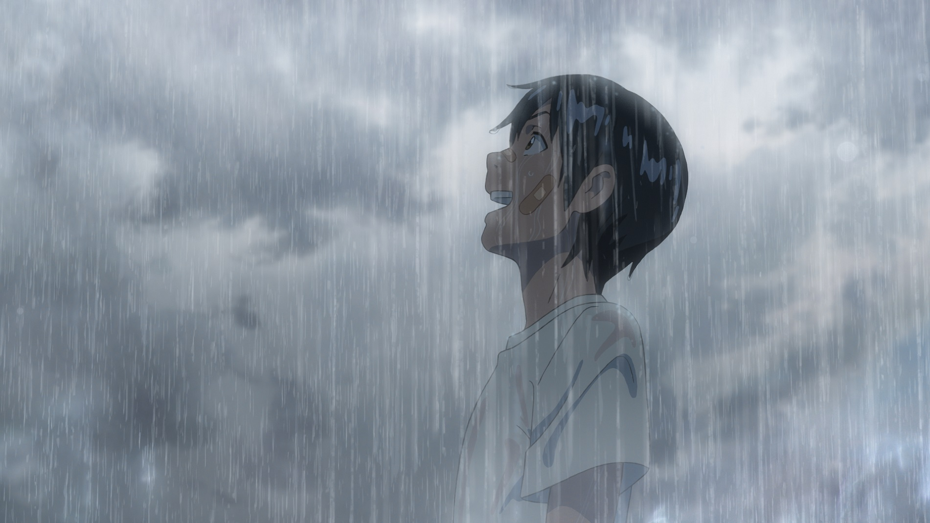 a young man with a bandaged face stands in the pouring rain, looking delighted, in the anime film Weathering With You
