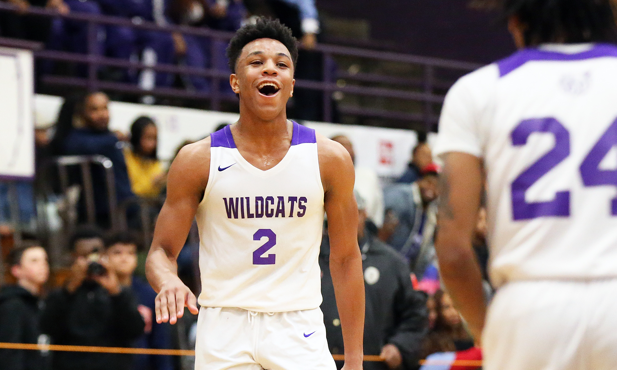 Thornton's DJ Williams (2) starts to celebrate with Ari Brown (24) after the Wildcats defeat Homewood-Flossmoor.