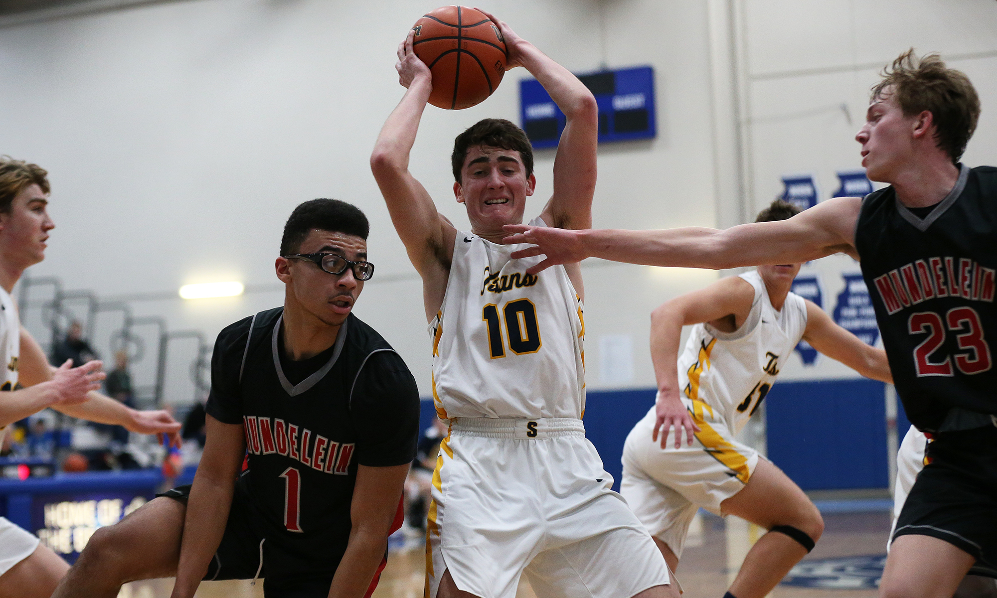 Glenbrook South's Danny Pauletto (10) grabs a rebound against Mundelein.