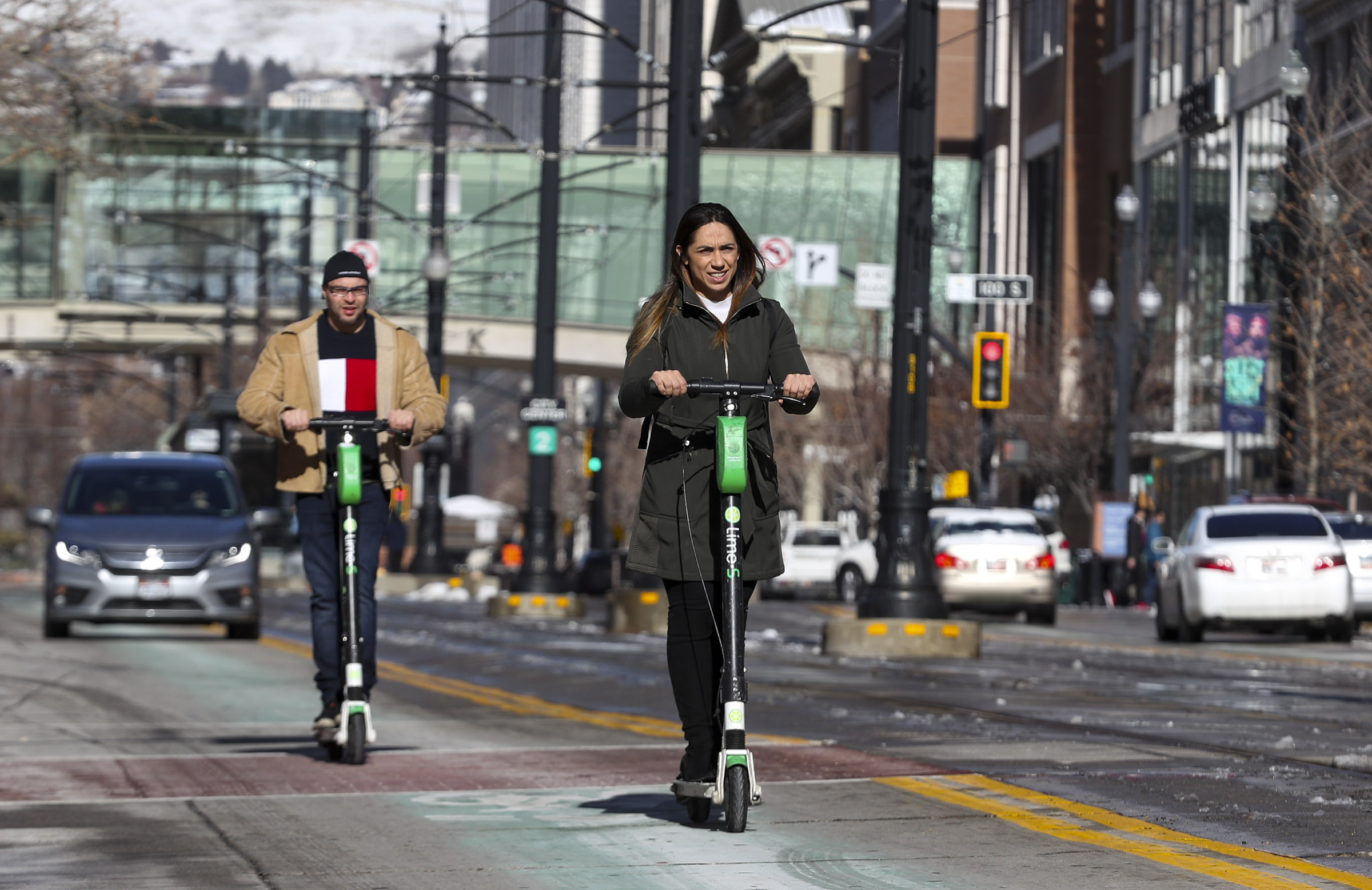 E-scooter riders make their way down Main Street in downtown Salt Lake City on Wednesday, Jan. 15, 2020.