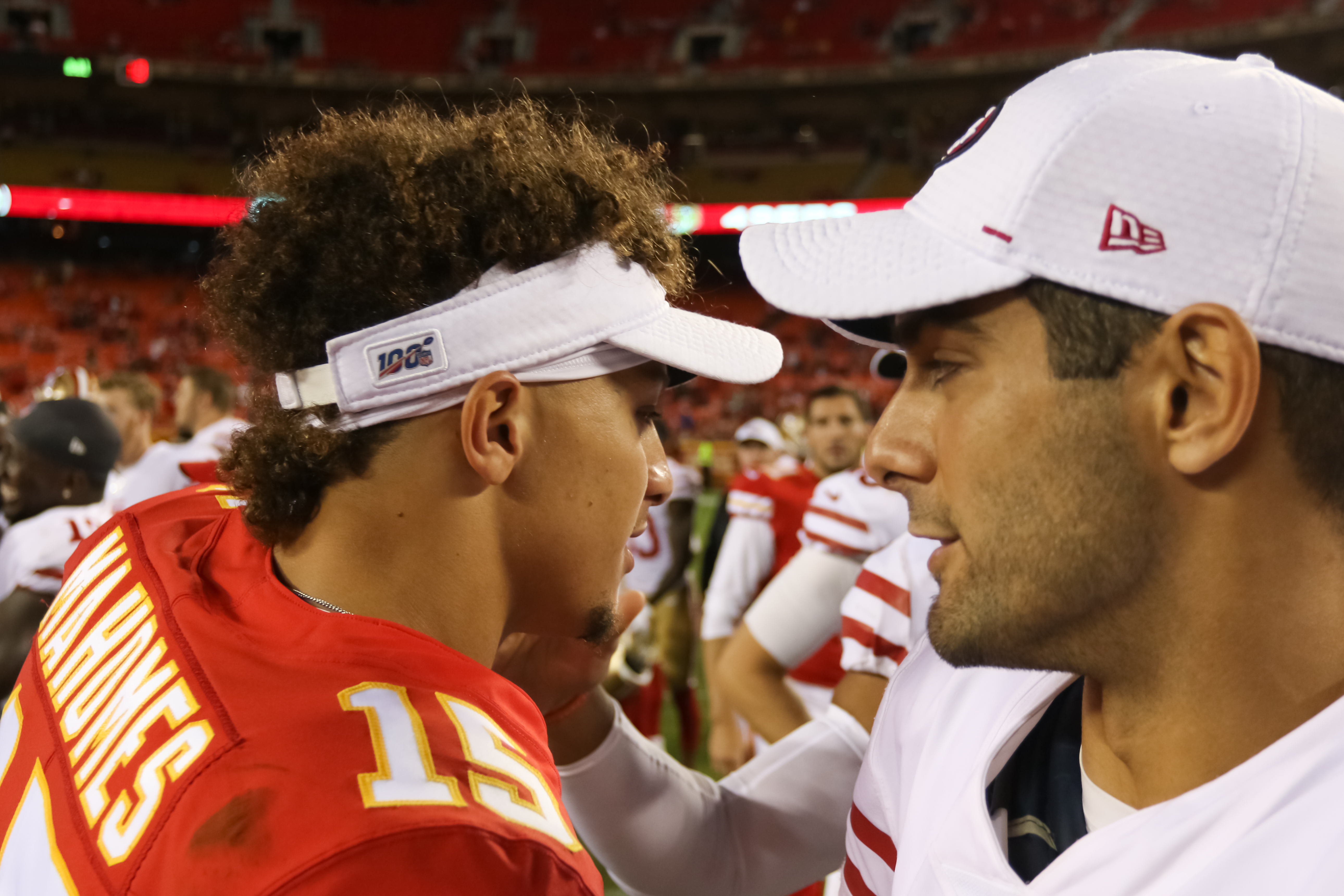 Kansas City Chiefs quarterback Patrick Mahomes and San Francisco 49ers quarterback Jimmy Garoppolo exchange a handshake and words after an NFL preseason game between the San Francisco 49ers and Kansas City Chiefs on August 24, 2019 at Arrowhead Stadium in Kansas City, MO.