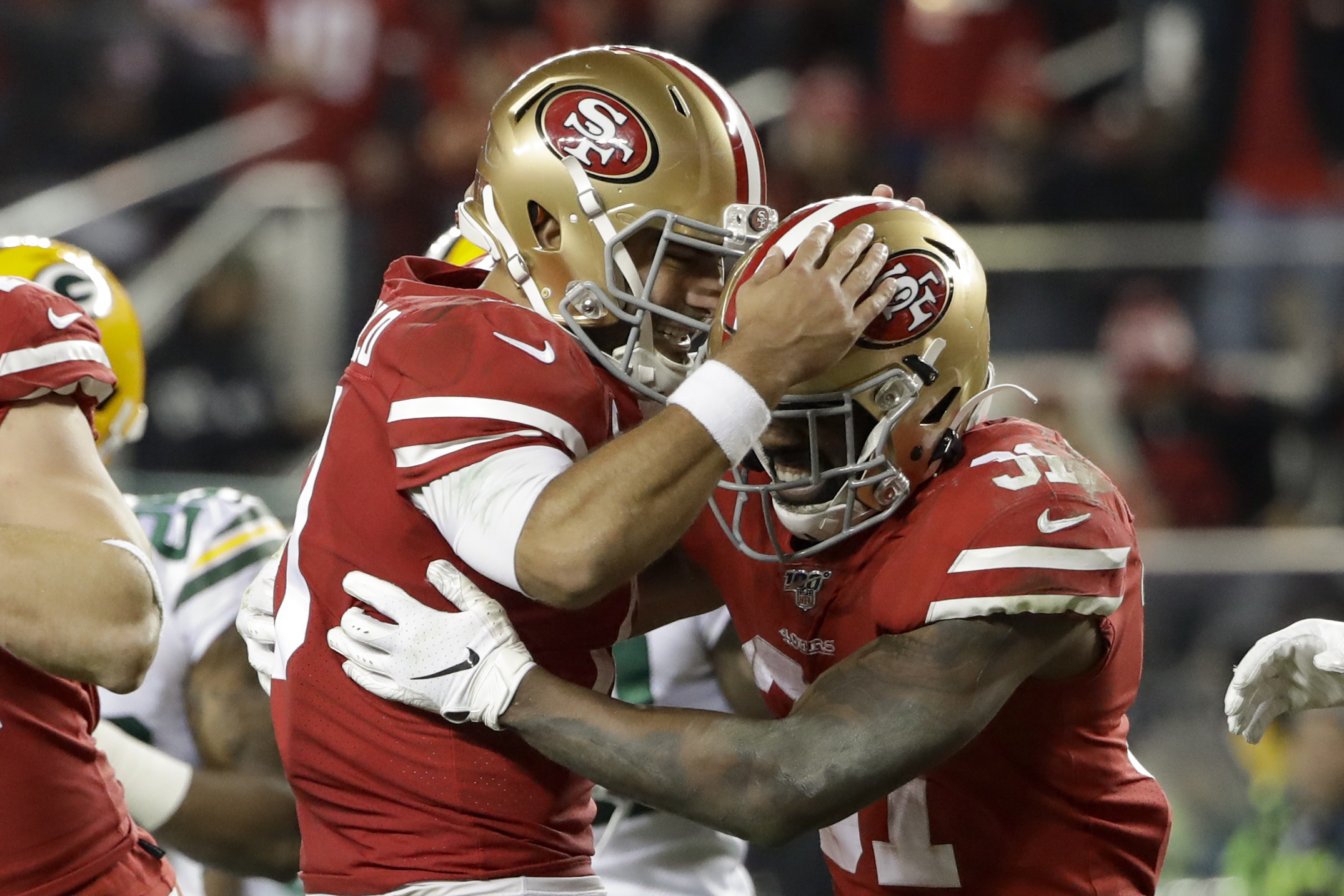 San Francisco 49ers running back Raheem Mostert, right, celebrates his touchdown with quarterback Jimmy Garoppolo during the second half of the NFL NFC Championship football game against the Green Bay Packers Sunday, Jan. 19, 2020, in Santa Clara, Calif. (AP Photo/Marcio Jose Sanchez)