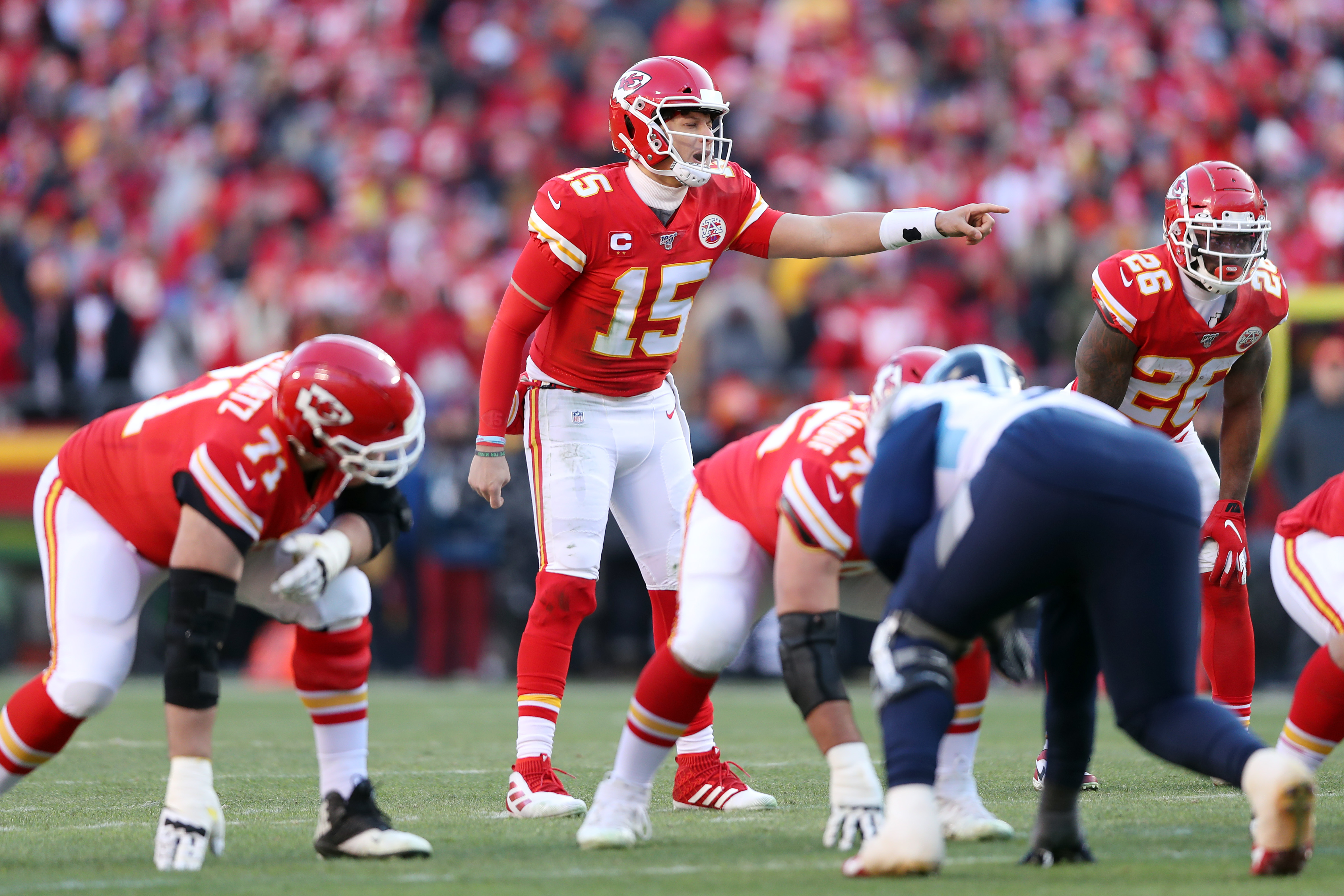 Patrick Mahomes of the Kansas City Chiefs gestures at the line in the first half against the Tennessee Titans in the AFC Championship Game at Arrowhead Stadium on January 19, 2020 in Kansas City, Missouri.