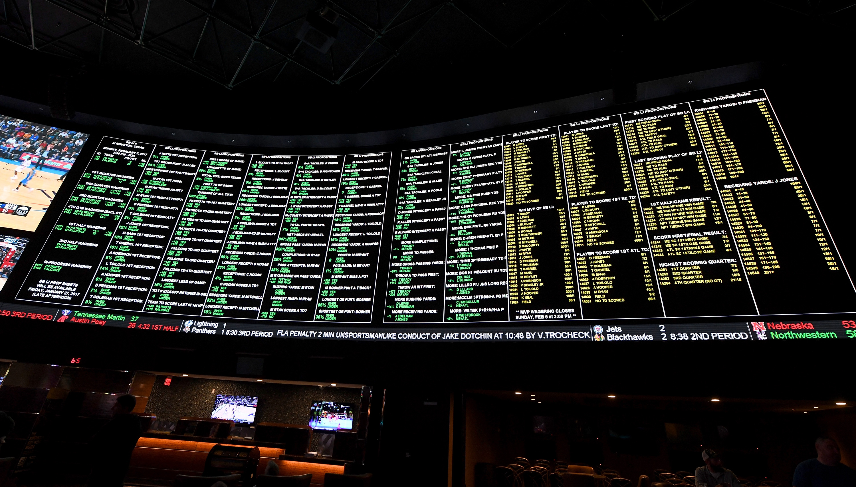 The betting line and some of the more than 400 proposition bets for Super Bowl LI between the Atlanta Falcons and the New England Patriots are displayed at the Race & Sports SuperBook at the Westgate Las Vegas Resort & Casino on January 26, 2017 in Las Vegas, Nevada.