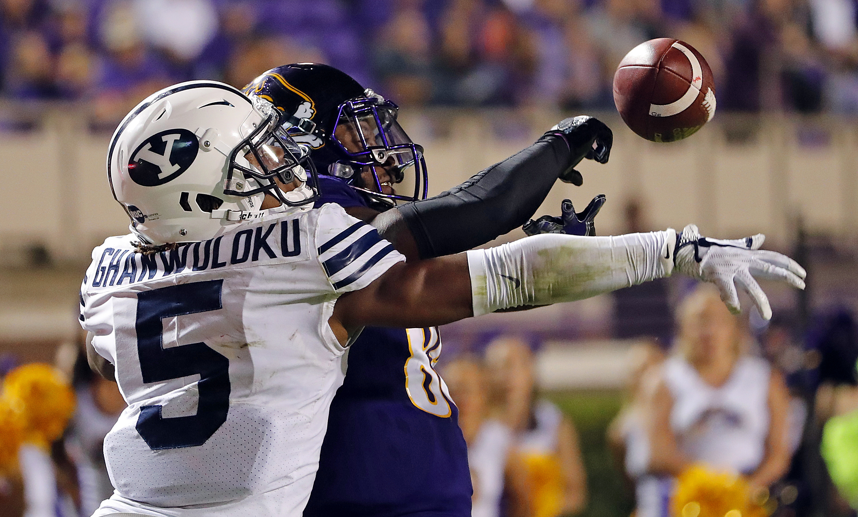 BYU's Dayan Ghanwoloku (5) knocks the ball away from East Carolina's Trevon Brown (88) during the second half of an NCAA college football game in Greenville, N.C., Saturday, Oct. 21, 2017.