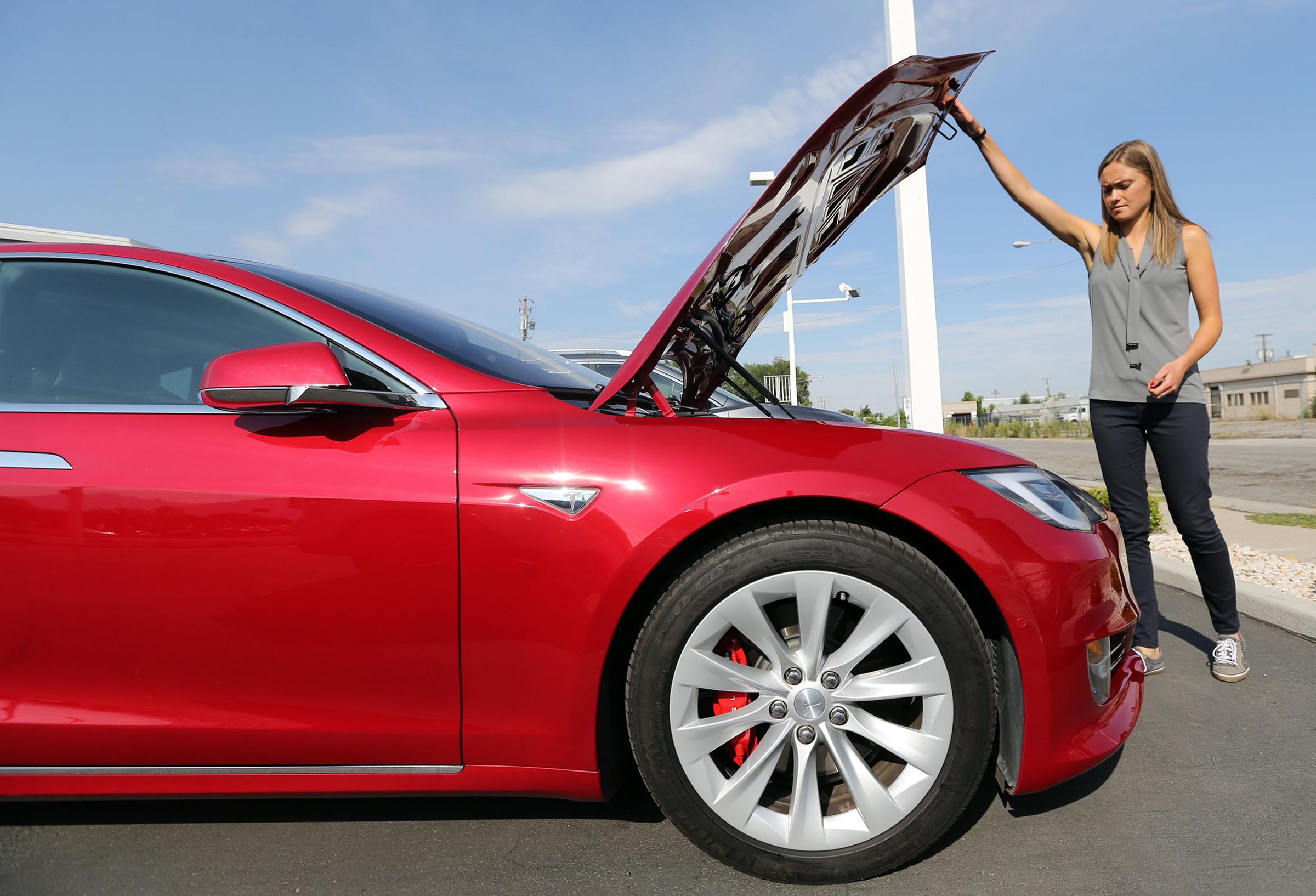 Sonja Koch, Tesla communications spokeswoman, shows storage space under the hood of a Tesla Model S P90D outside the Tesla showroom in Salt Lake City on Tuesday, Aug. 23, 2016.