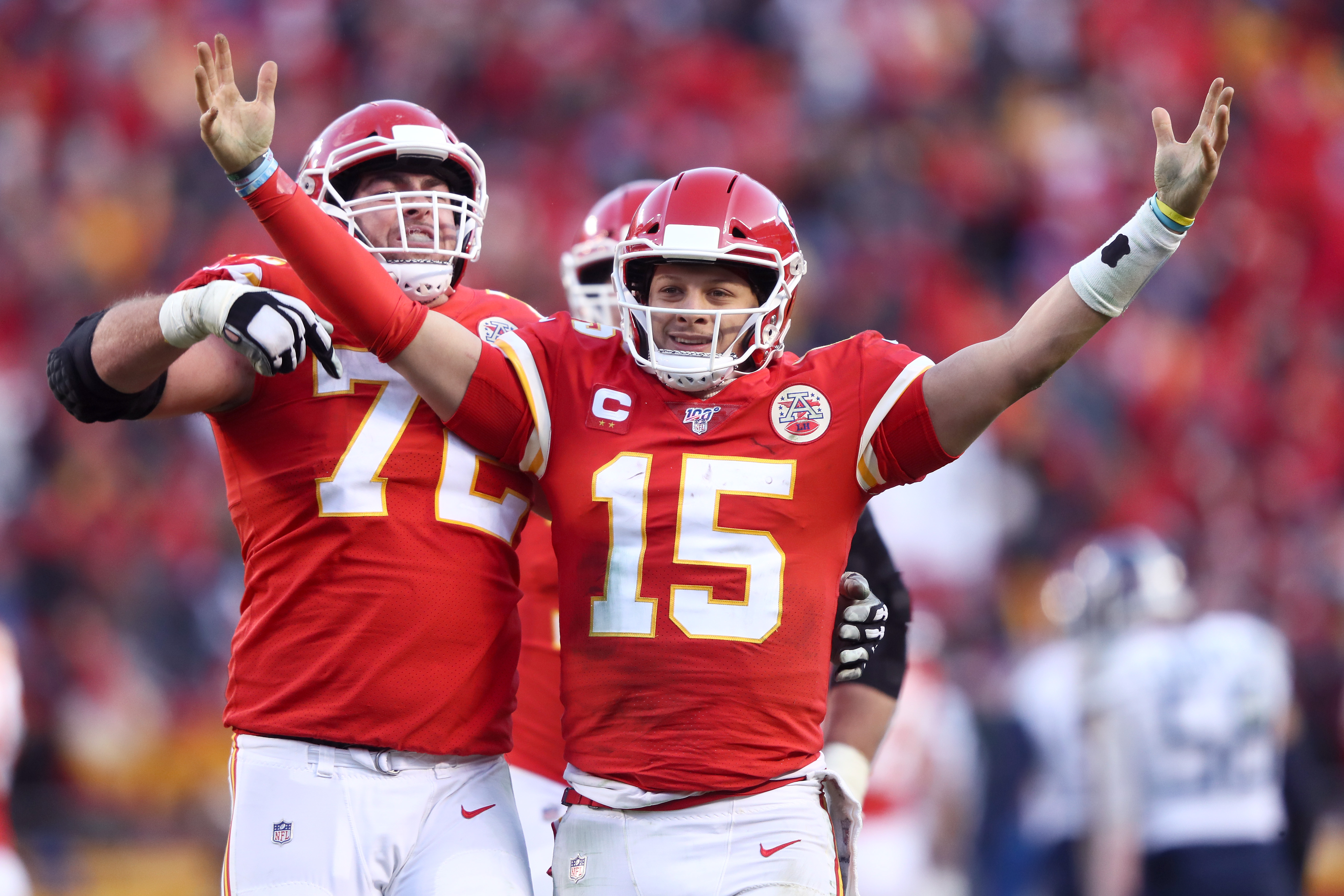 Patrick Mahomes of the Kansas City Chiefs reacts with teammate Eric Fisher after a fourth quarter touchdown pass against the Tennessee Titans in the AFC Championship Game at Arrowhead Stadium on January 19, 2020 in Kansas City, Missouri.