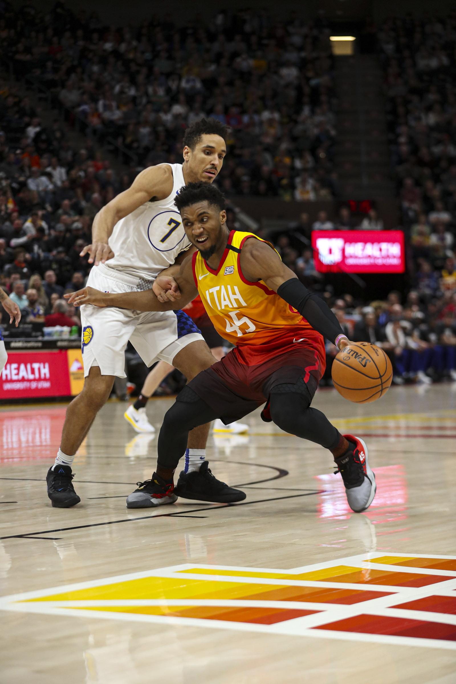 Utah Jazz guard Donovan Mitchell (45) moves around Indiana Pacers guard Malcom Brogdon (7) during an NBA game at Vivint Arena in Salt Lake City on Monday, Jan. 20, 2020.