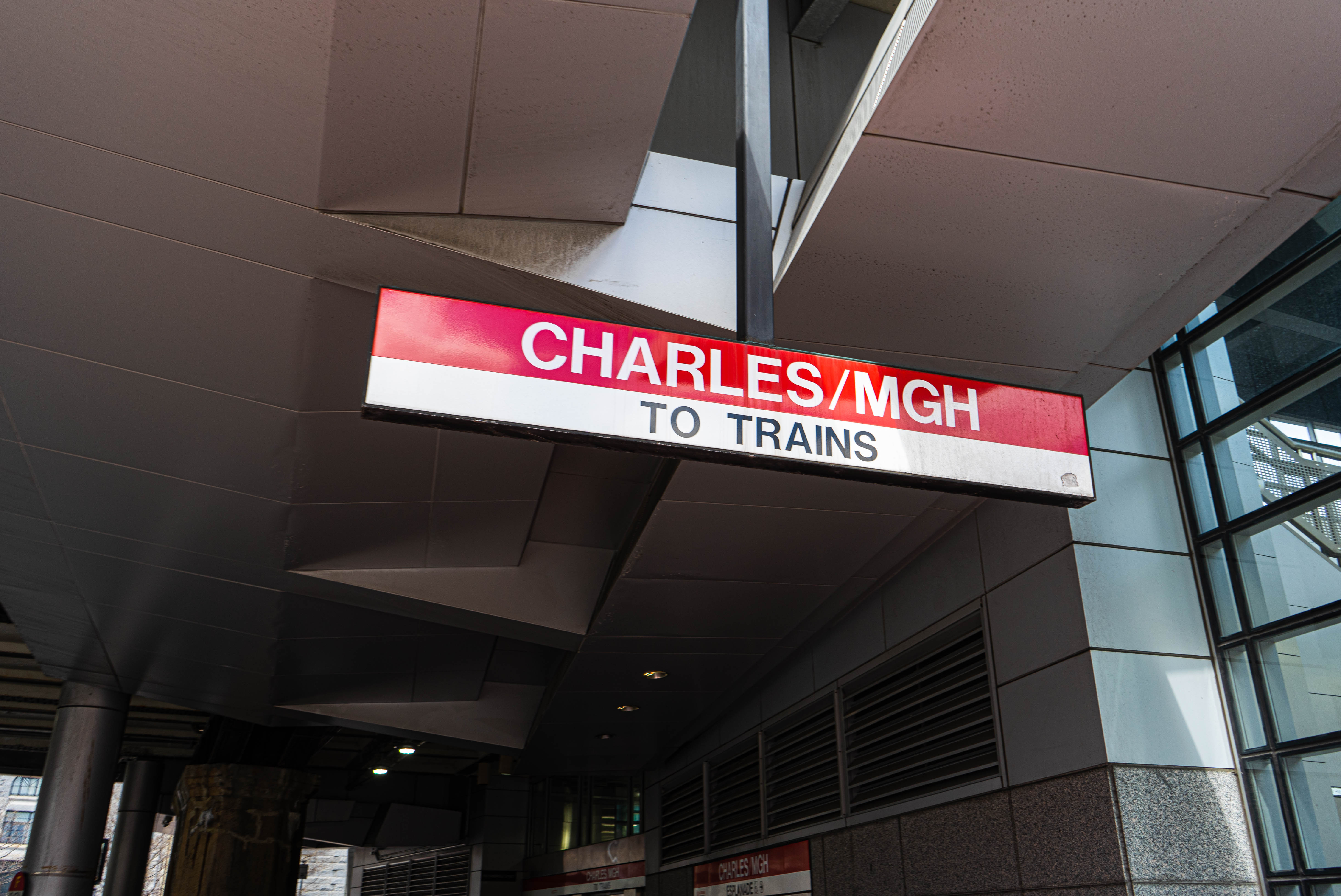 """A subway sign that reads """"Charles/MGH To Trains."""""""