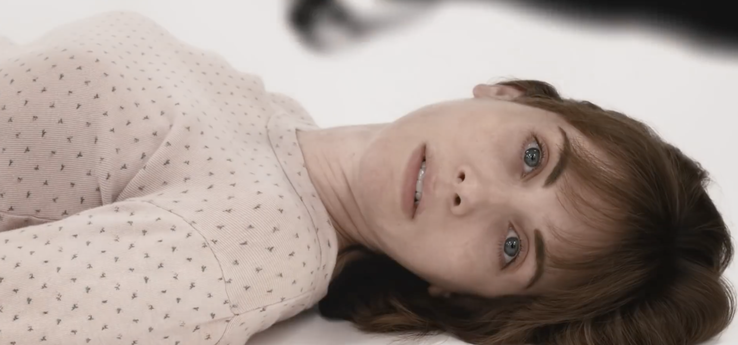 Sarah (Alison Brie) lying on the ground in Horse Girl