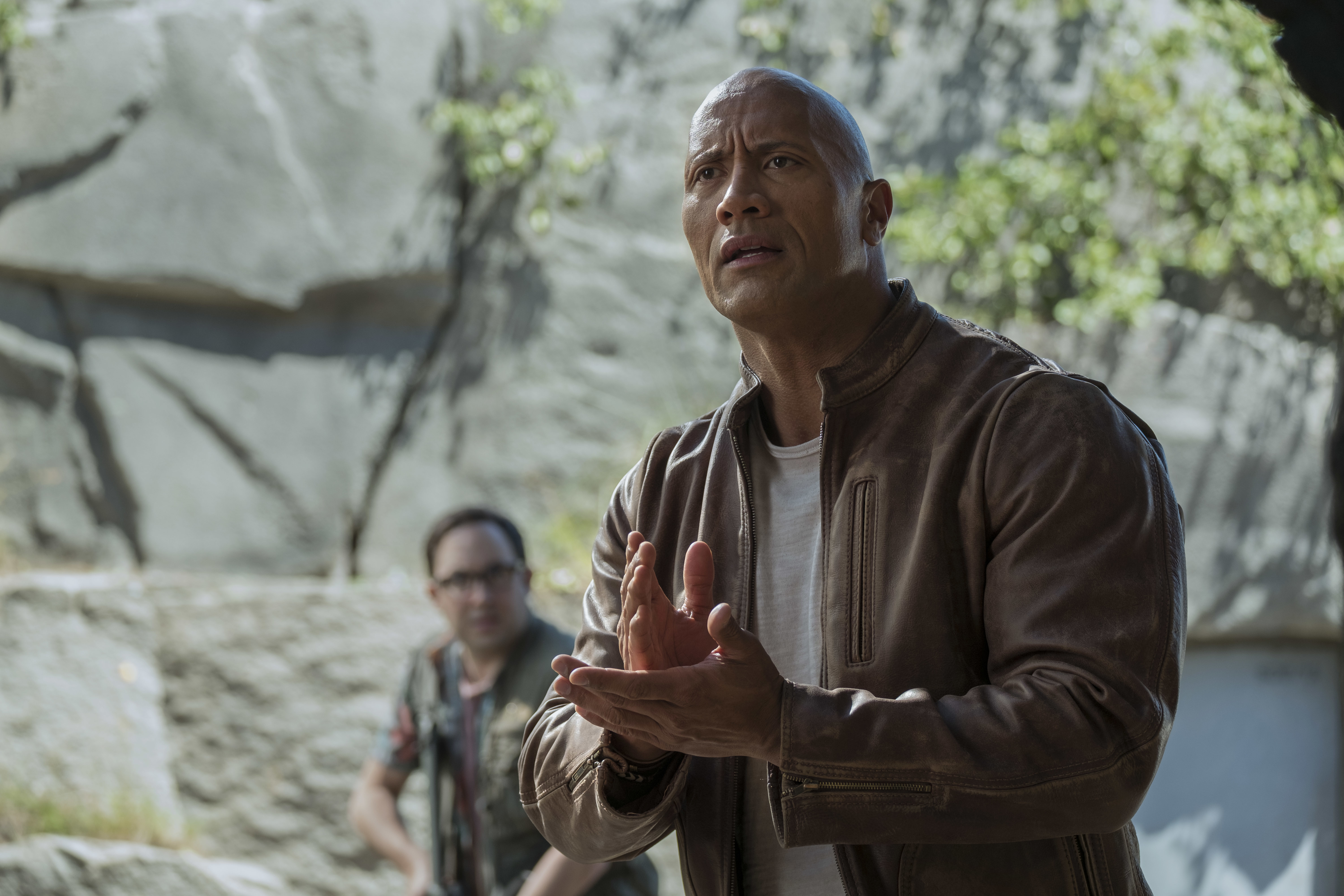 "P.J. Byrne as Nelson and Dwayne Johnson as Davis Okoye in ""Rampage."""