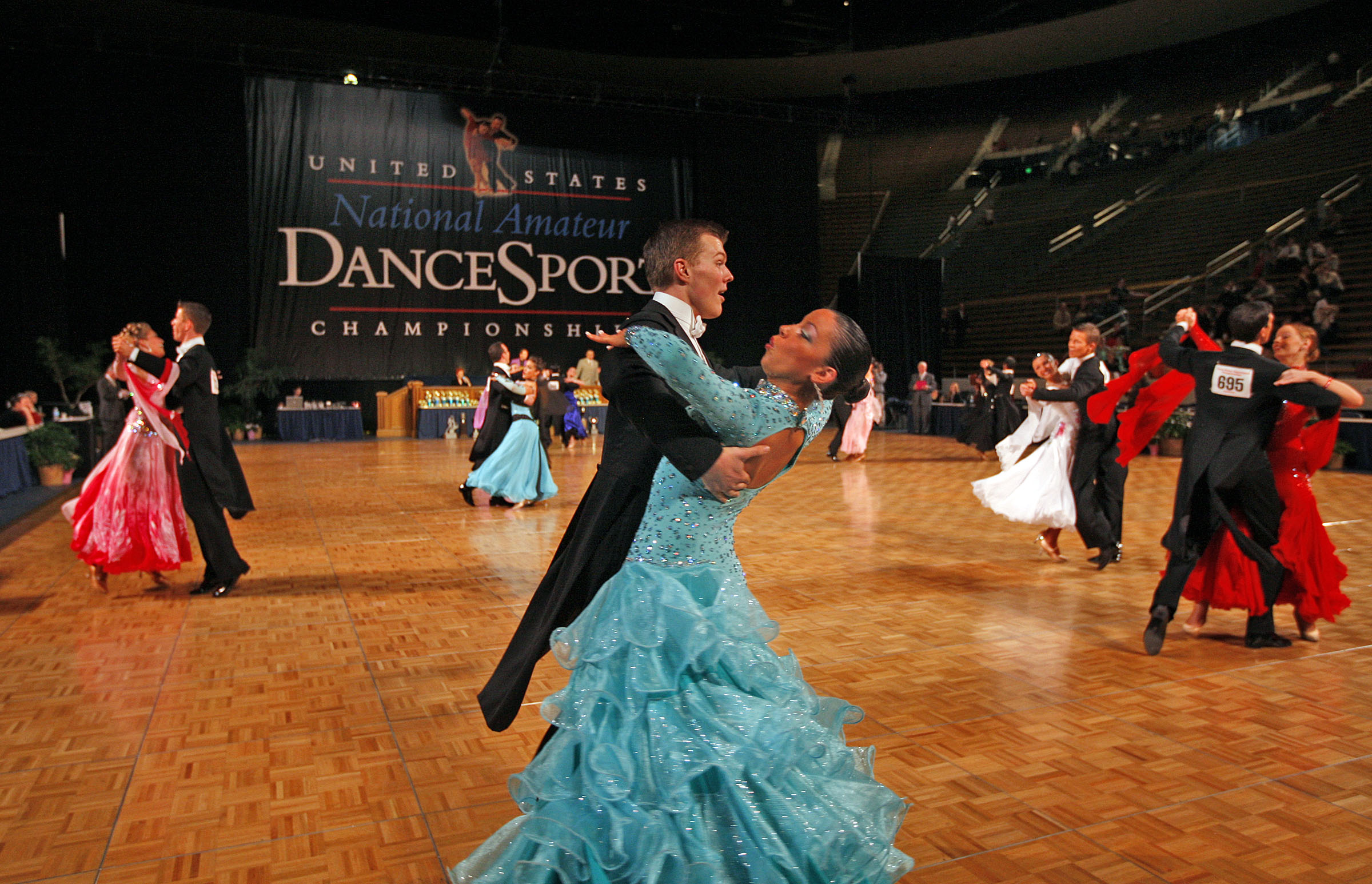 Couples dance in the preliminary rounds as dundreds of ballroom dancers of all ages sweep compete as BYU hosts the United States National Amateur DanceSport Championship...among the largest amateur ballroom dance events in the country, participants include dancers age kindergarten up in six categories, with titles awarded in Latin, standard, smooth, rhythm, cabaret and formationThursday, March 12, 2009, in Provo, Utah.