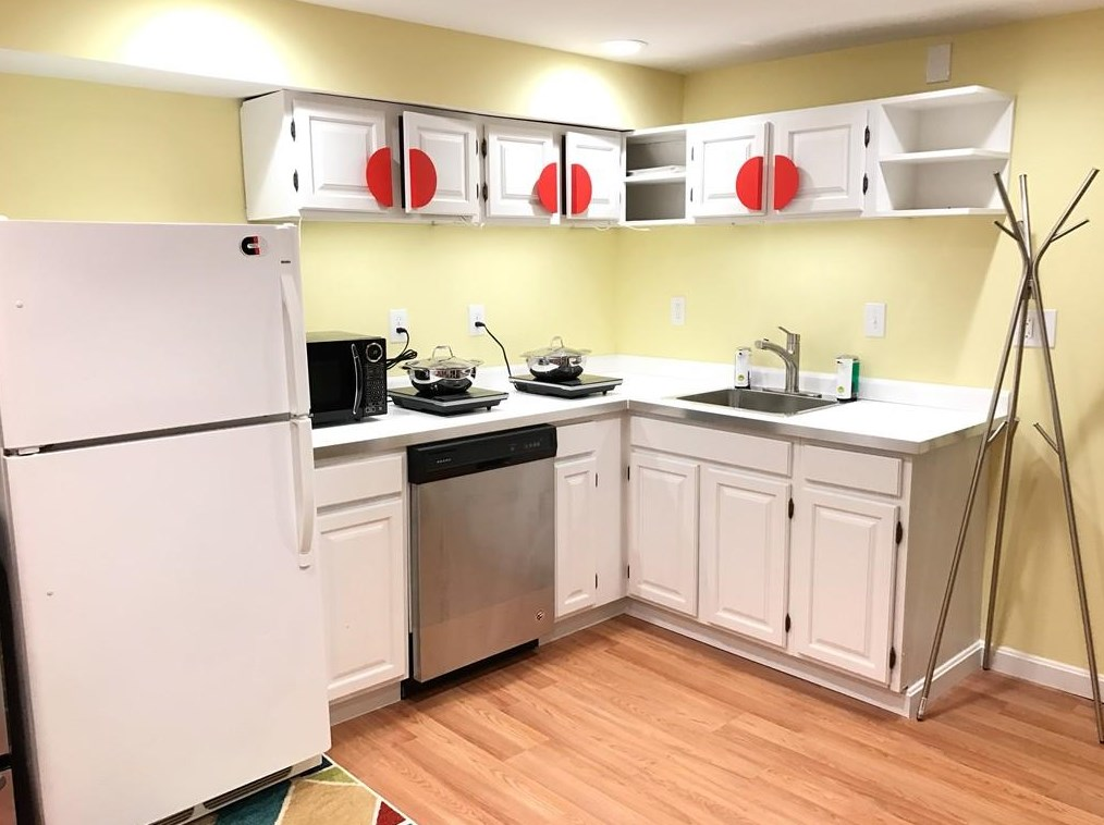 A small kitchen with counters meeting at a right angle.