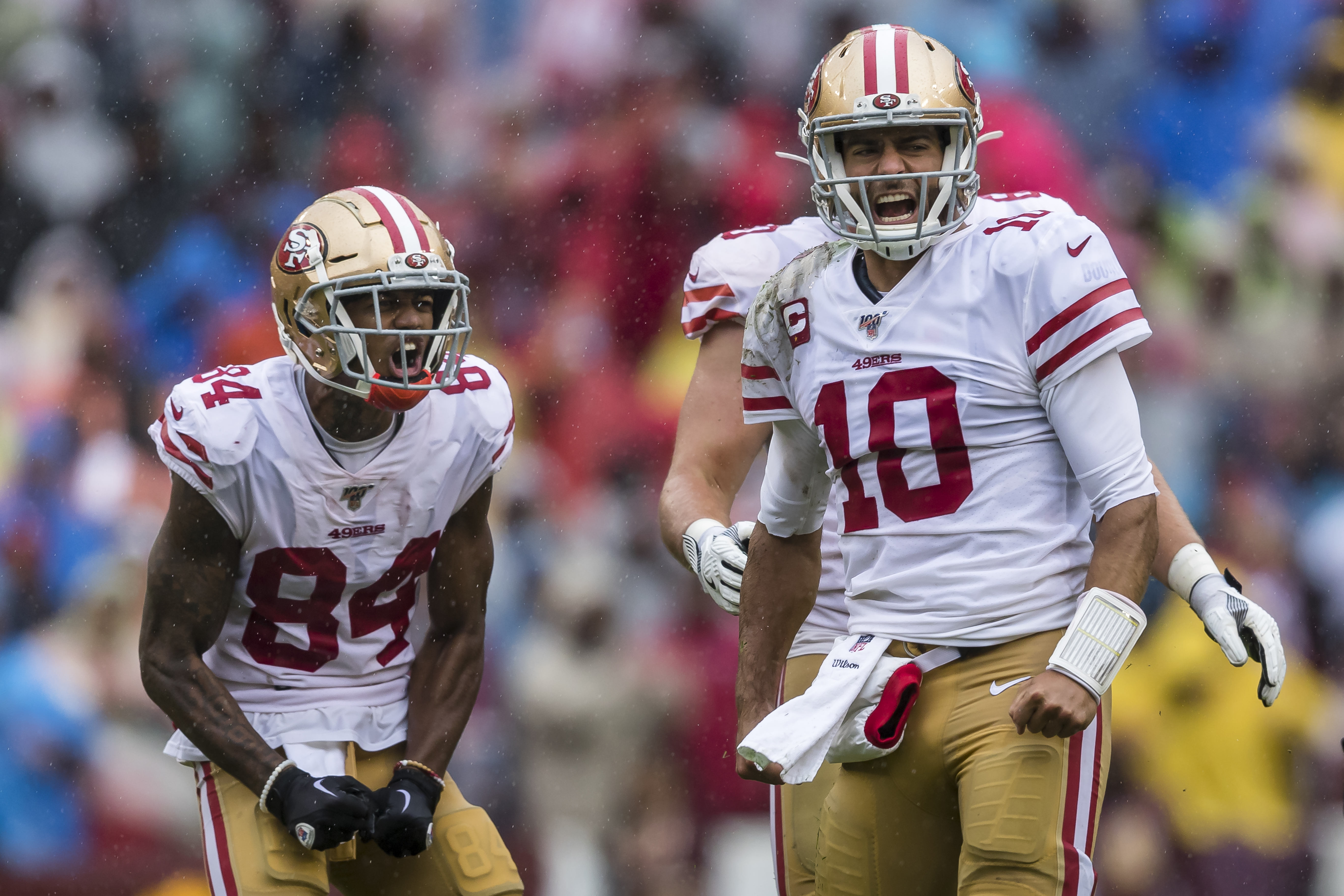 Jimmy Garoppolo and Kendrick Bourne of the San Francisco 49ers reacts after gaining a first down against Washington during the first half at FedExField on October 20, 2019 in Landover, Maryland.