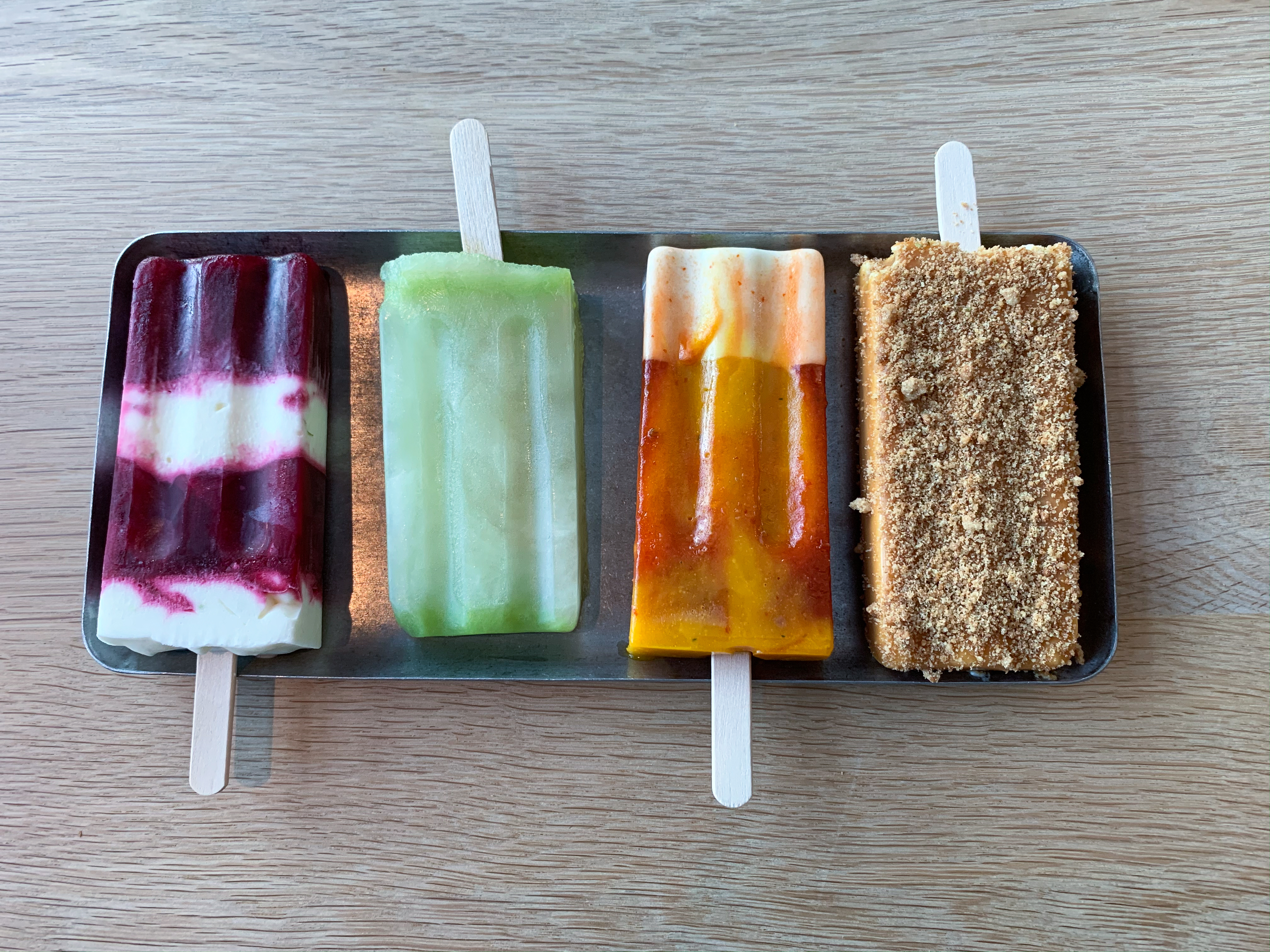 four popsicles on a plate