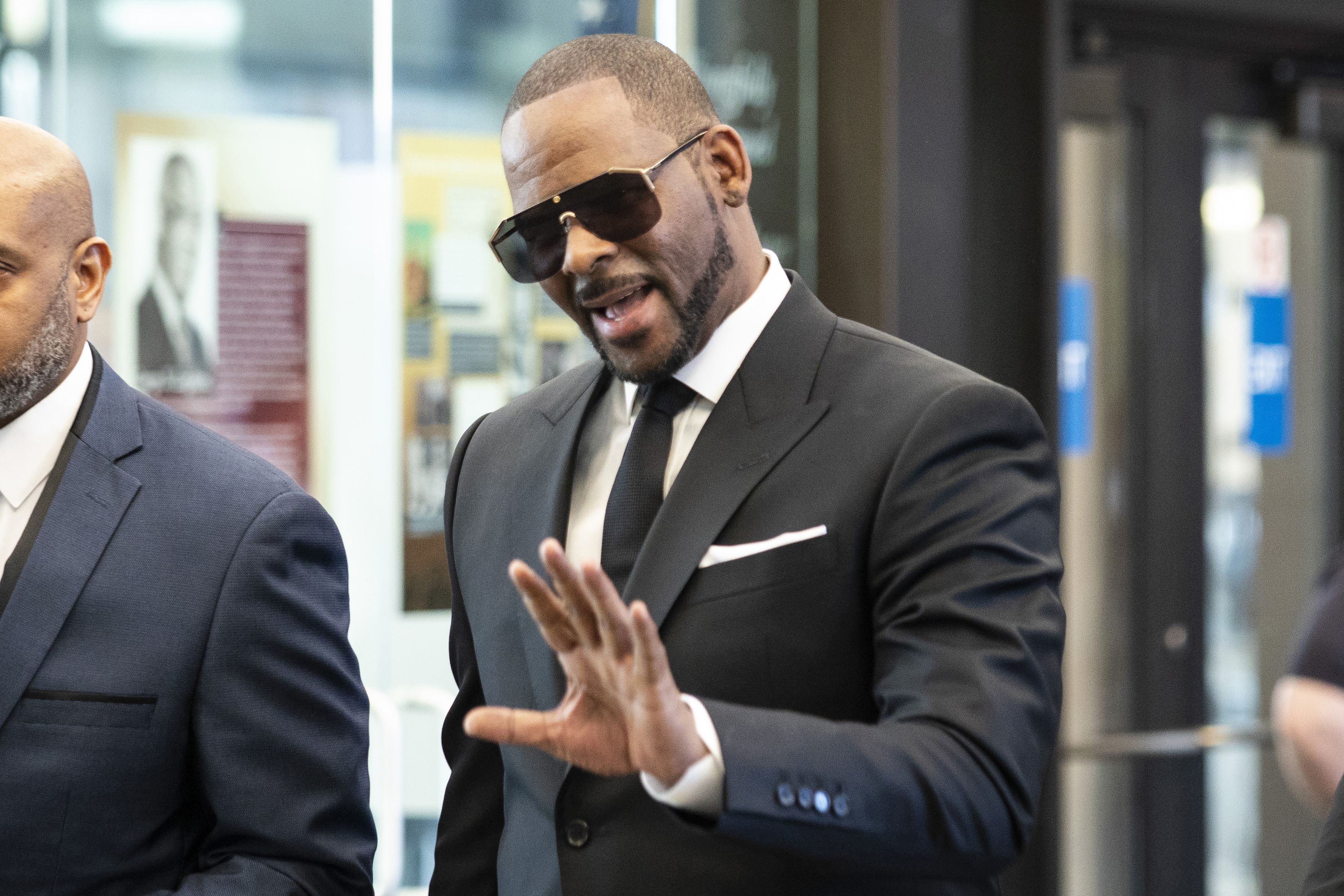 In this March 22, 2019, file photo, musician R. Kelly walks into the Leighton Criminal Courthouse for a hearing in his criminal sexual abuse trial in Chicago.