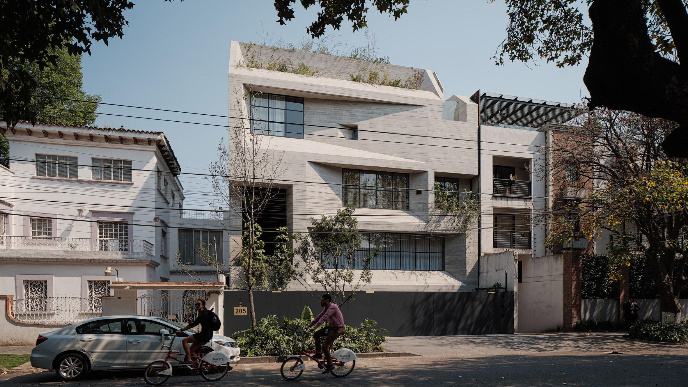 Exterior of concrete apartment complex with rectangular windows.