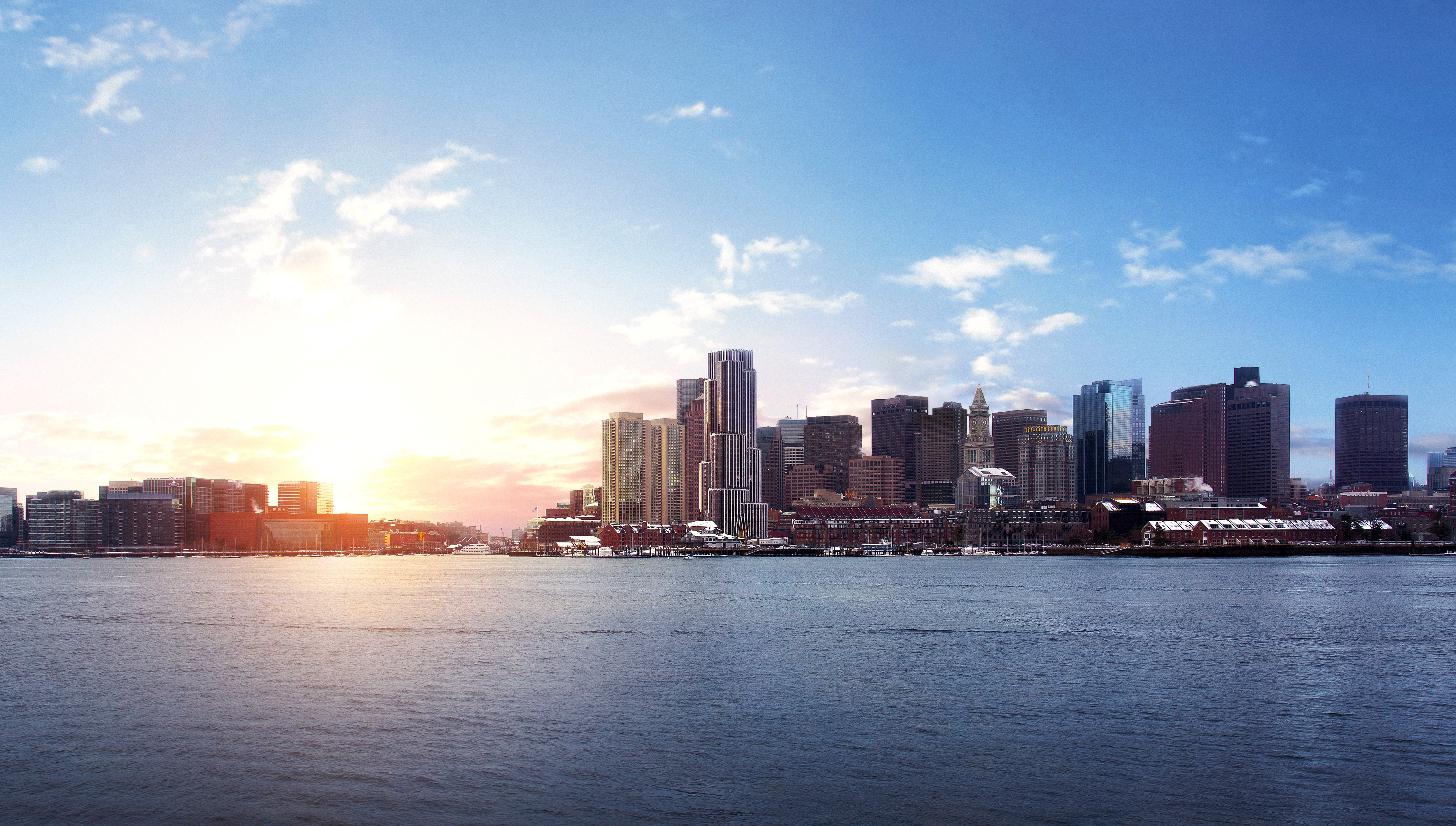 Rendering of a city skyline on a harbor, with many tall buildings.