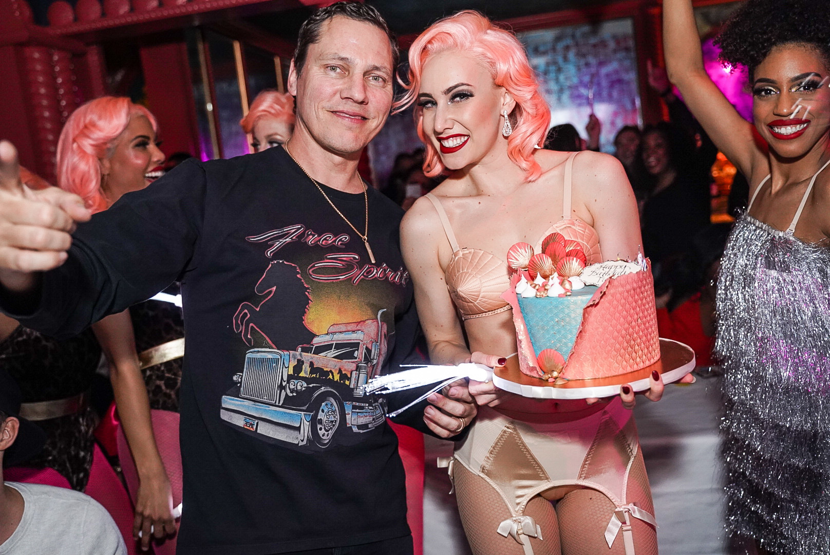 A man and a woman holding a cake