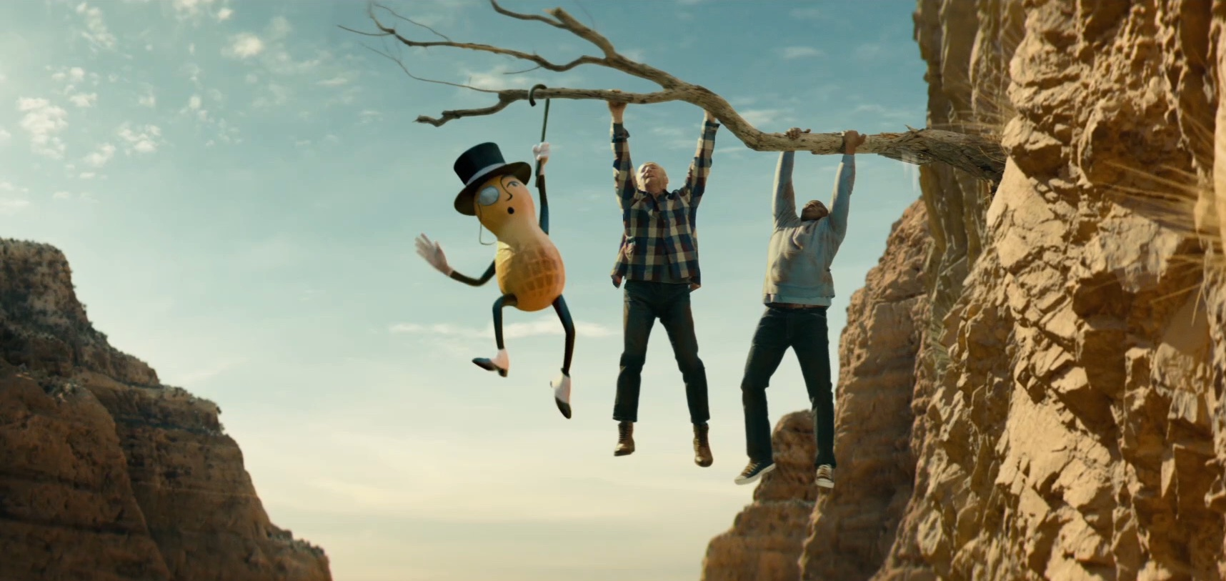 Mr. Peanut, Matt Walsh and Wesley Snipes are hanging on a tree branch in the new Planters Peanuts Super Bowl ad in which Mr. Peanut gives up his life to save his pals.