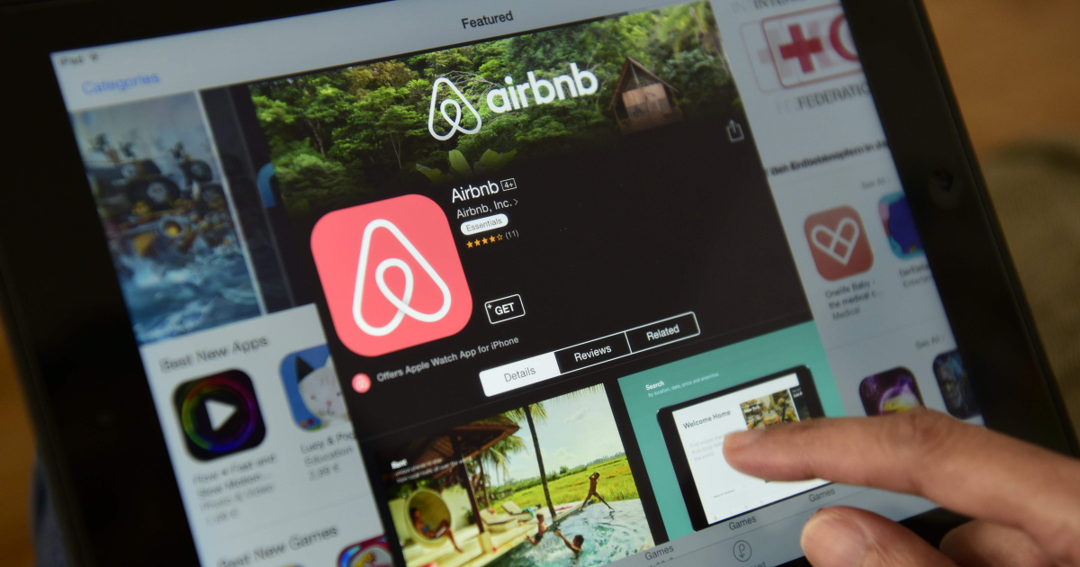 A woman browses the site of US home sharing giant Airbnb on a tablet.