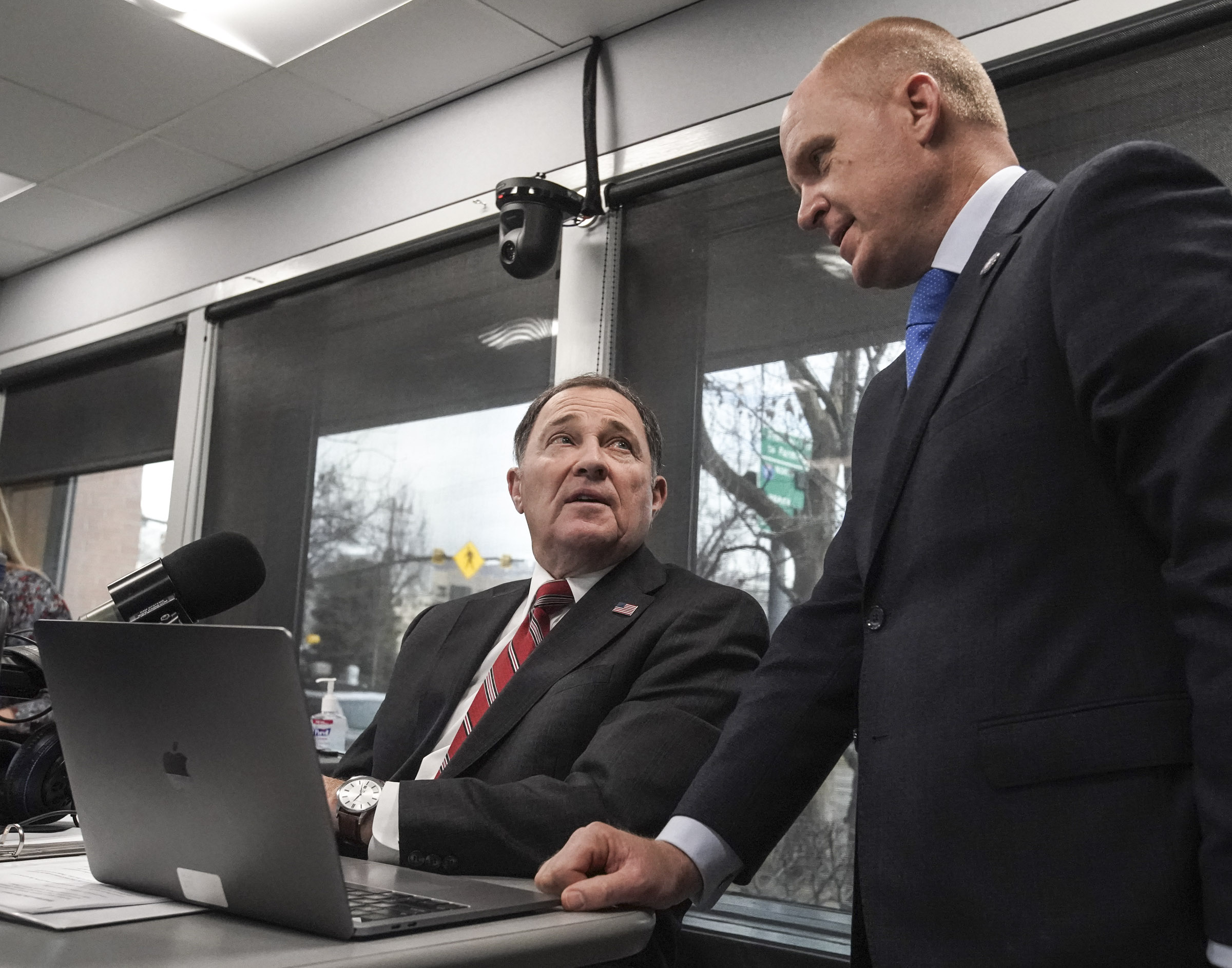 "Gov. Gary Herbert, left, talks with chief of staff Justin Harding during a break in KSL Newsradio's ""Let Me Speak to the Governor"" in Salt Lake City on Thursday, Jan. 23, 2020."