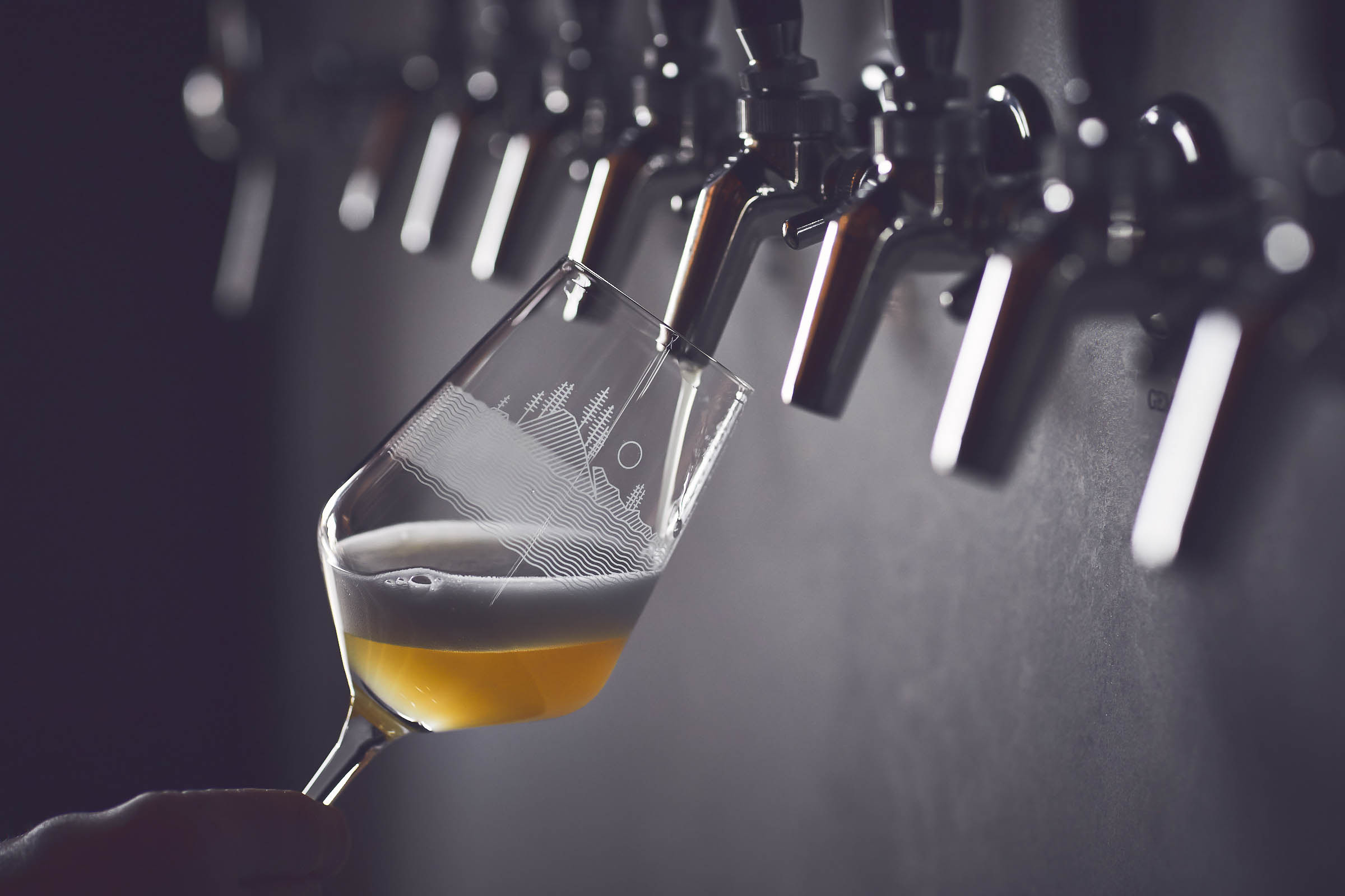 A beer being poured from a tap at Fair Isle Brewing in Ballard.