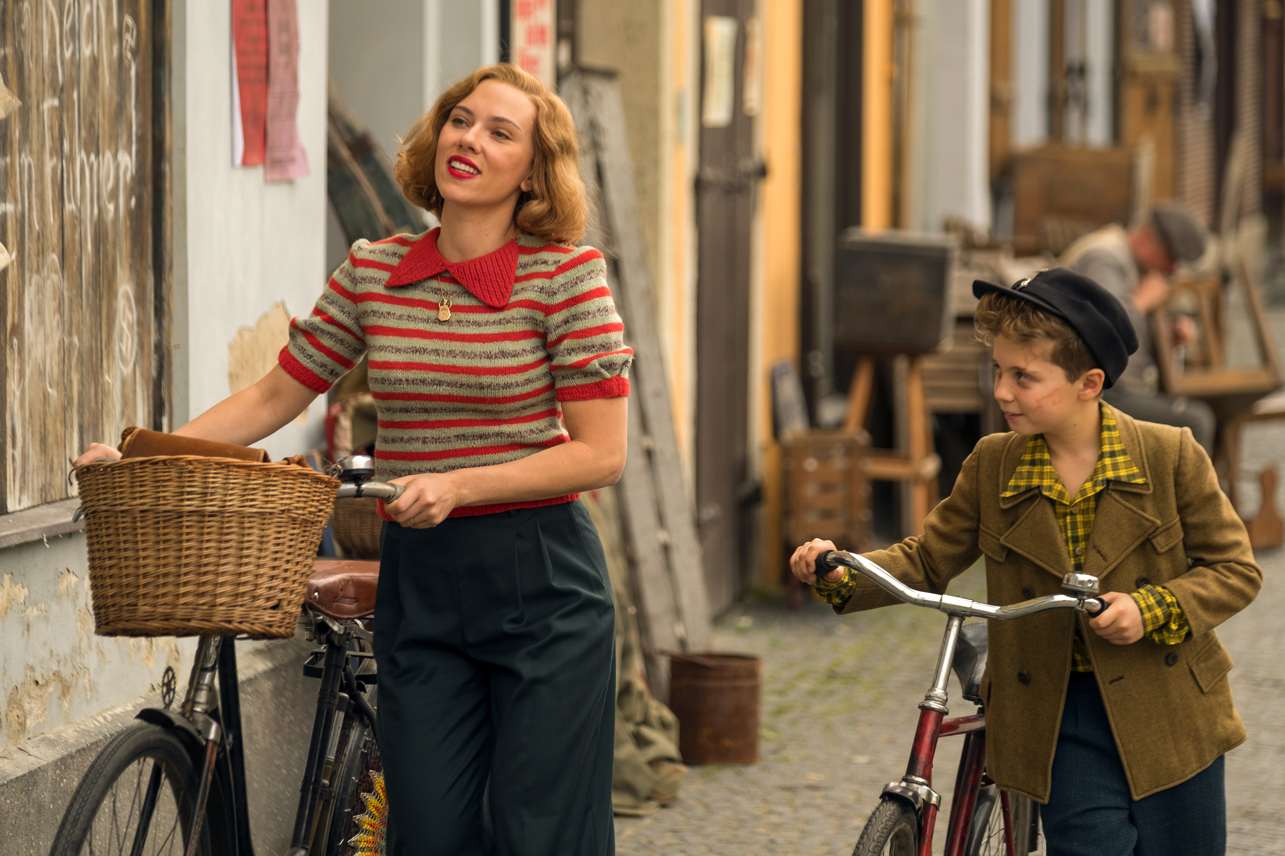 """This image released by Fox Searchlight Pictures shows Scarlett Johansson, left, and Roman Griffin Davis in a scene from the WWII satirical film """"Jojo Rabbit."""""""
