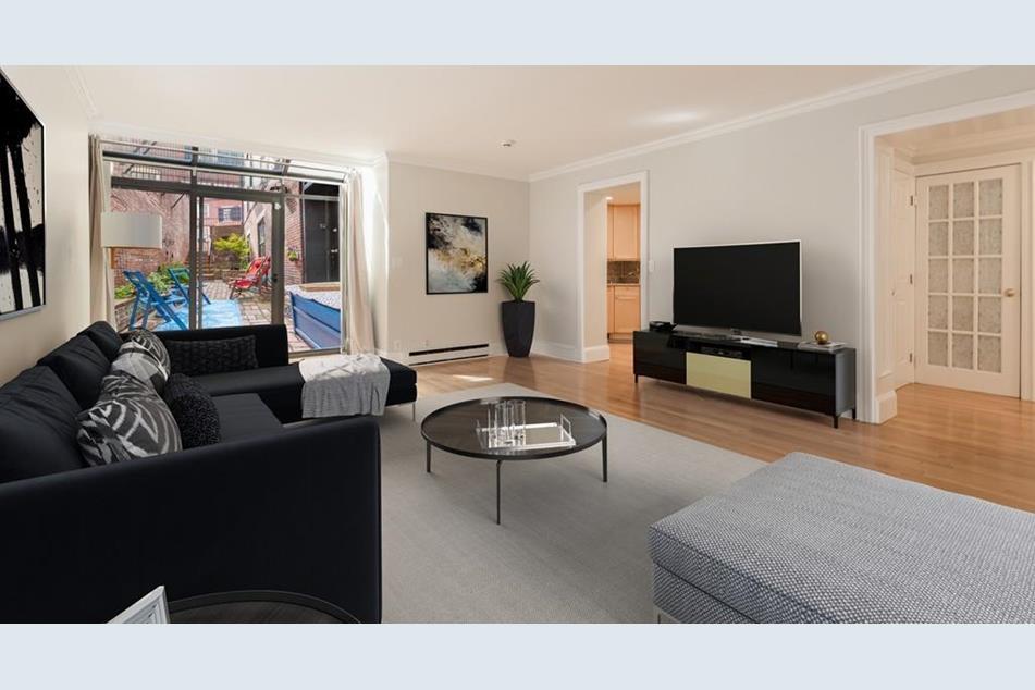 A spacious, contemporary living room in a condo.