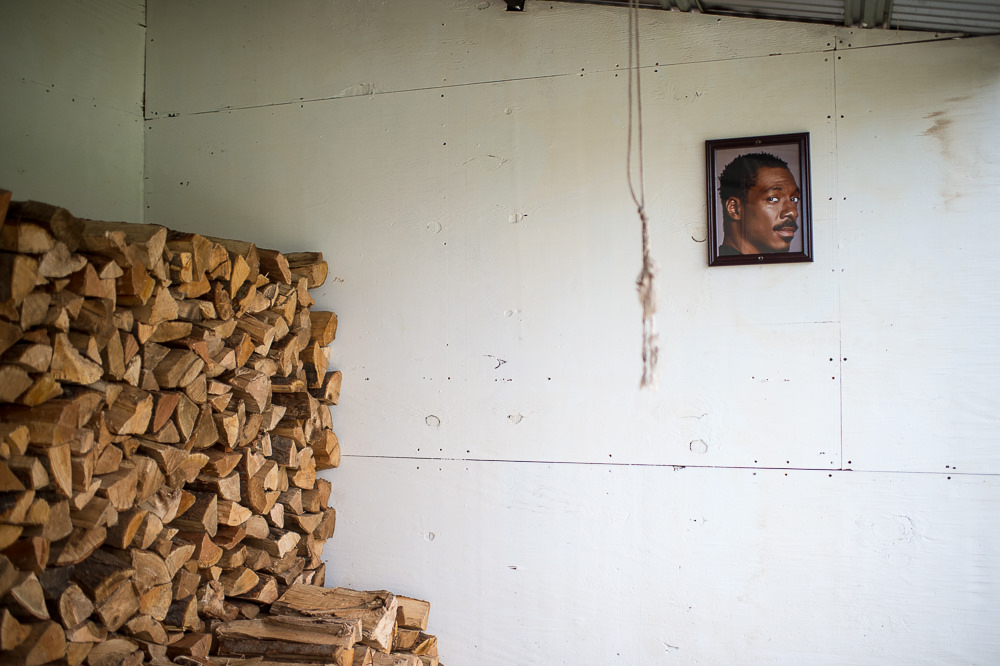 A photo of Eddie Murphy hangs near a pile of wood at Roberta's, sister spot to Blanca
