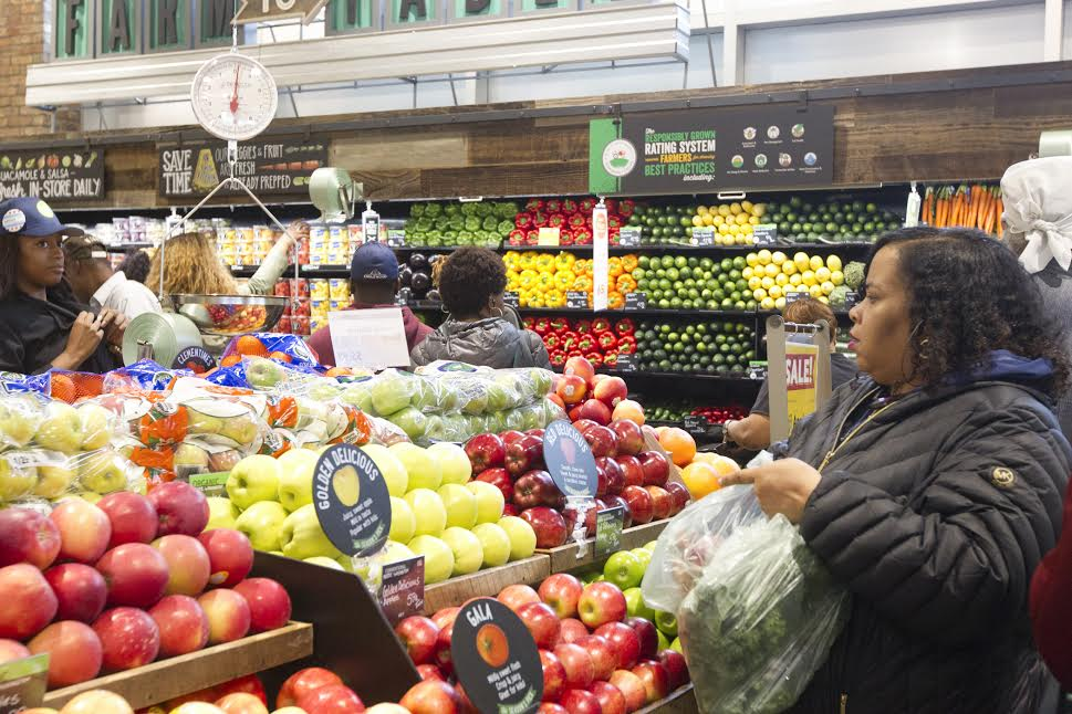 Customers shop for fresh fruits and vegetables at the at the Whole Foods at 63rd & Halsted in Englewood | Photo: Brooke Collins