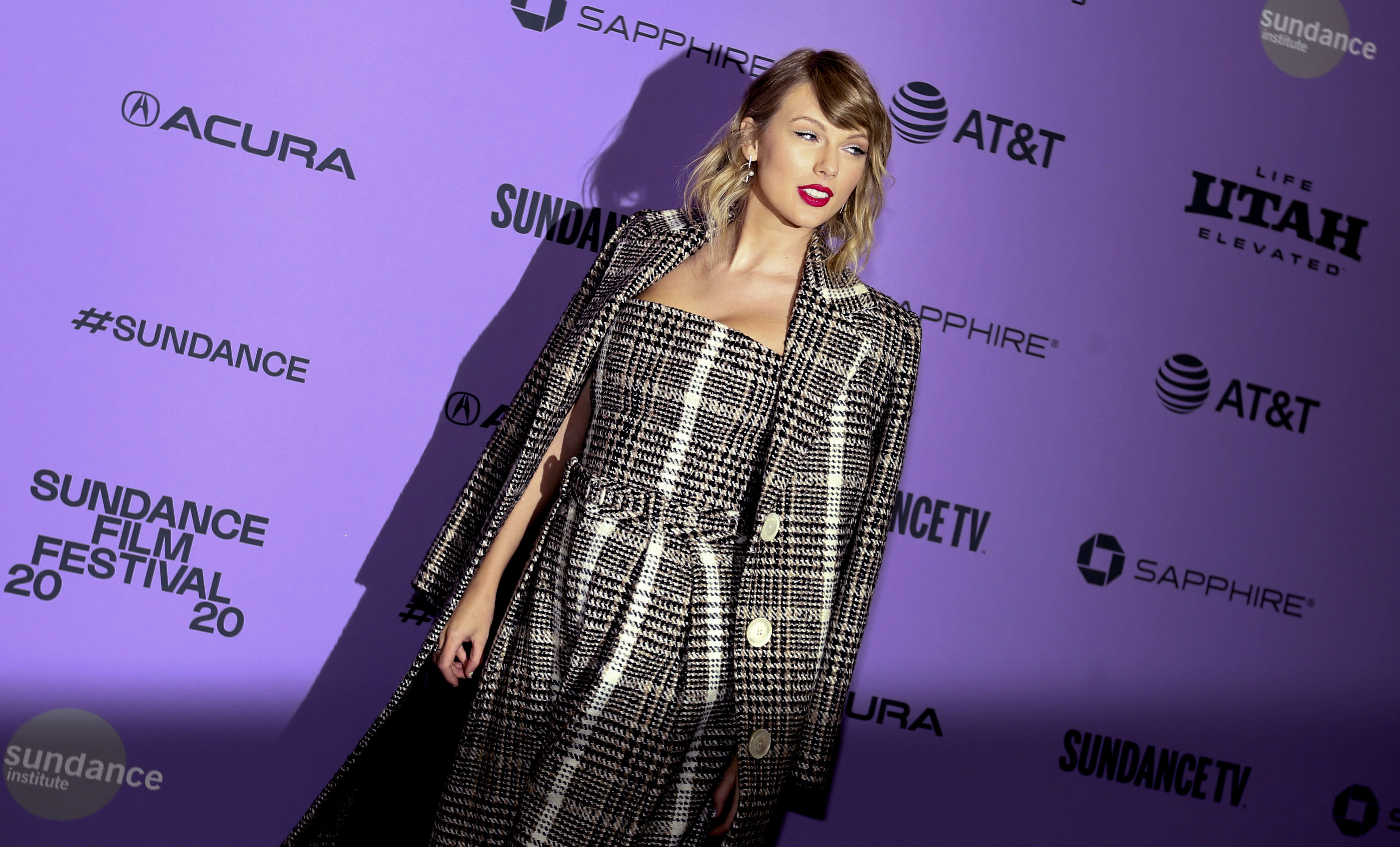 """Taylor Swift poses for photos before the premiere of the documentary """"Miss Americana"""" at the Eccles Theatre in Park City on Thursday, Jan. 23, 2020."""