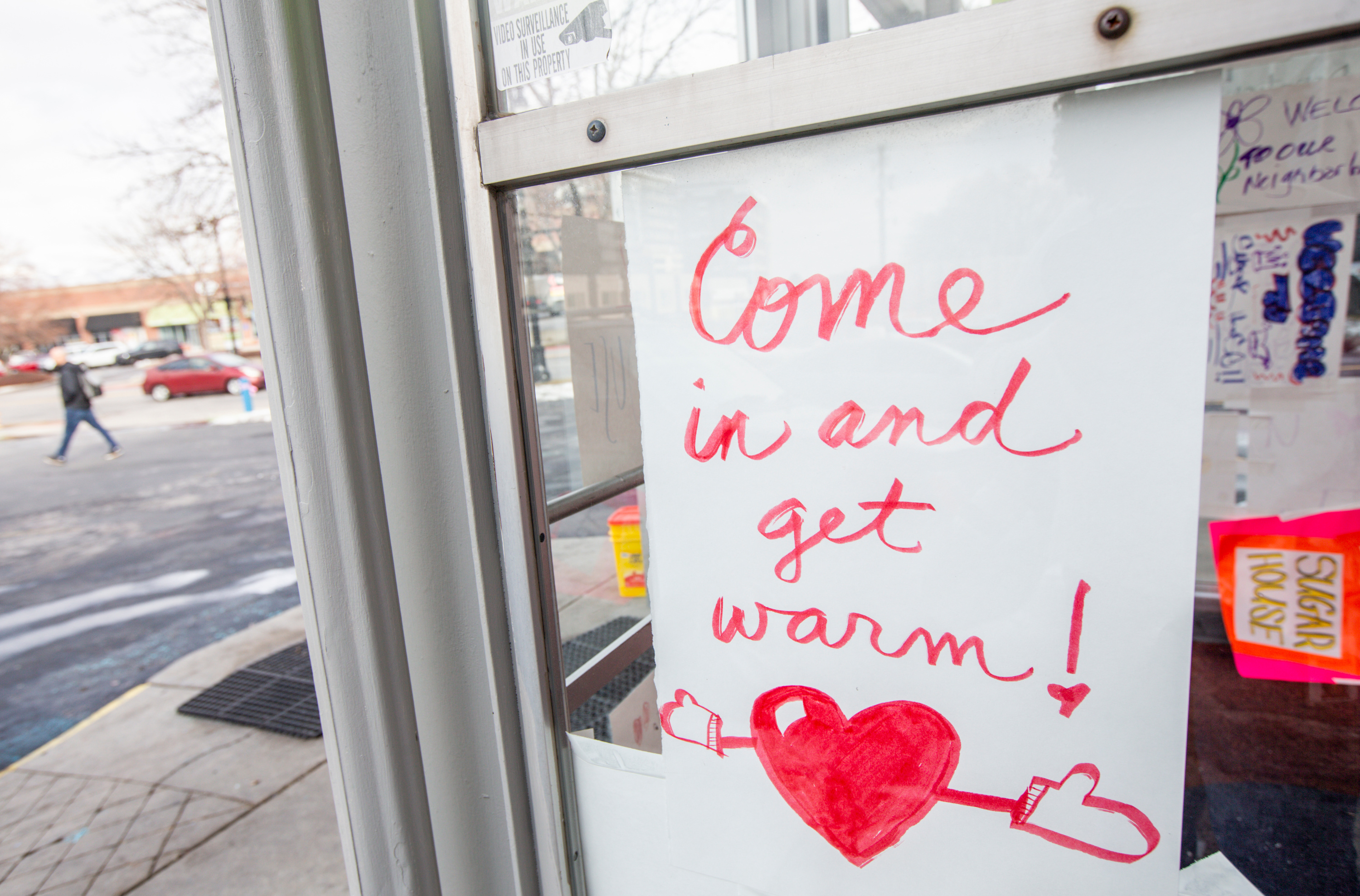 Posters showing neighborhood support decorate the entrance of the temporary Sugar House homeless shelter in Salt Lake City on Thursday, Jan. 23, 2020. The new shelter, which will provide cots, mats and blankets, opened Thursday night.