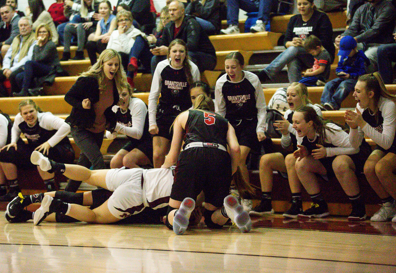 Grantsville girls basketball coach Megan Vera and members of the team cheer on their teammate during the Morgan vs. Grantsville game at Morgan High School in Morgan on Thursday, Jan. 23, 2020.
