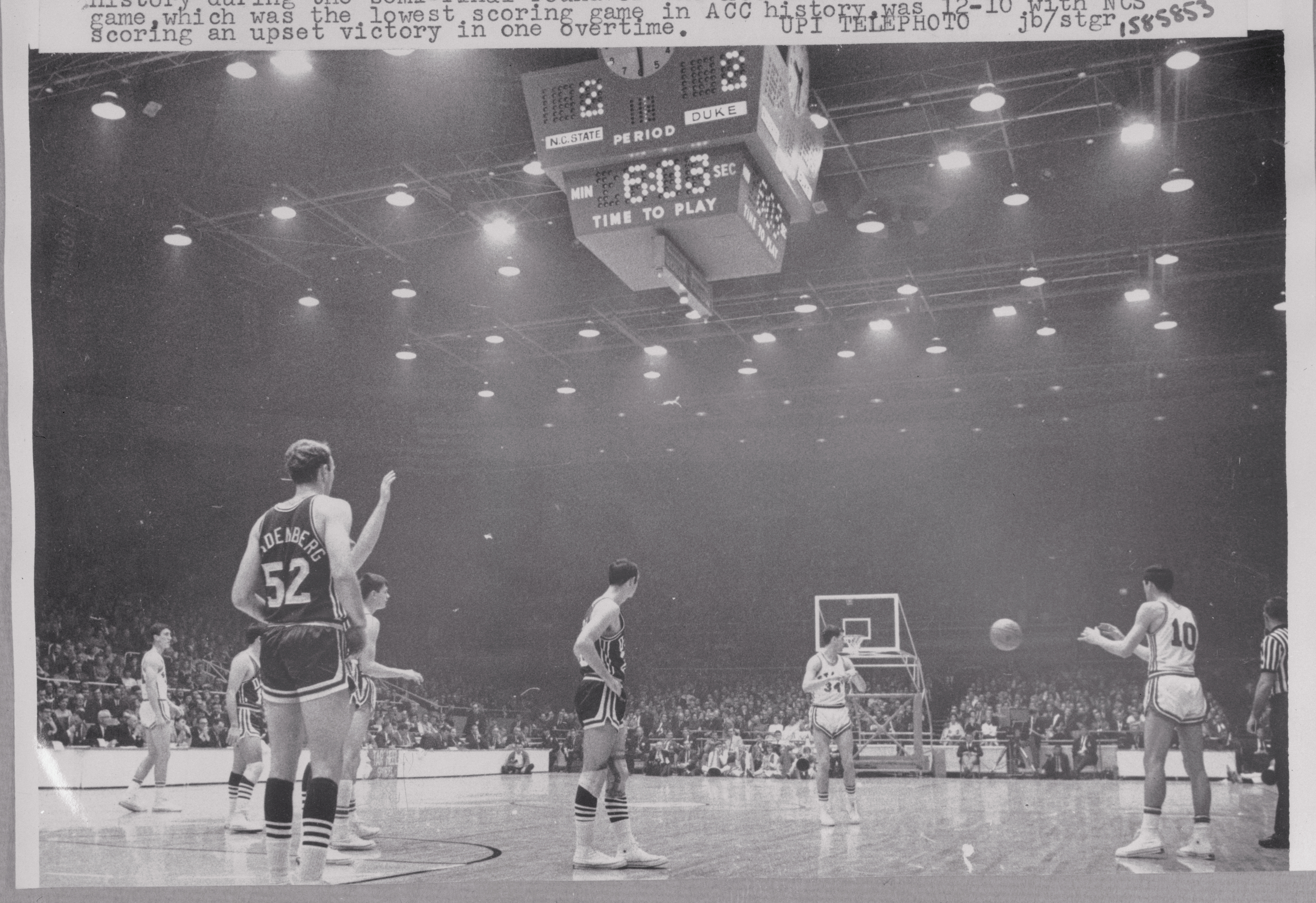 Basketball Players Competing in Game