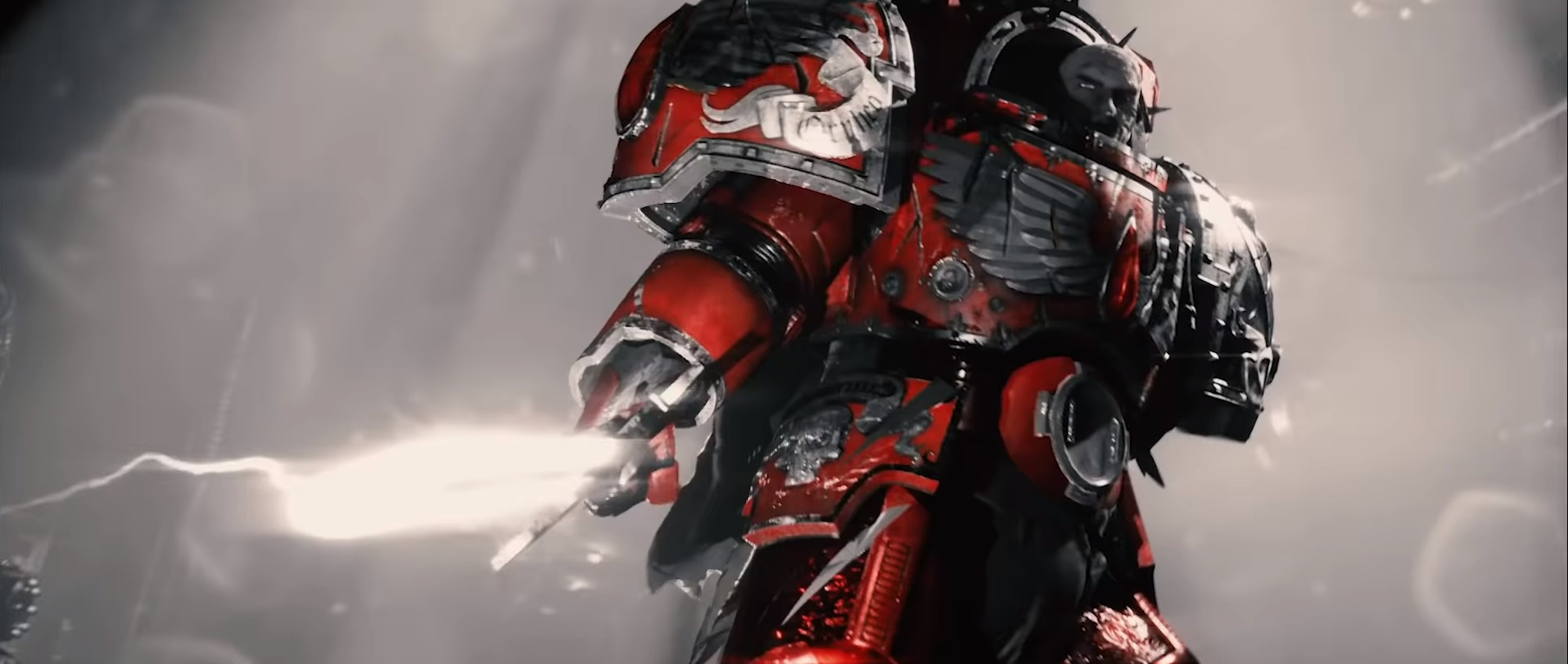 A Blood Angel Space Marine stands with an energy sword activated in the Warhammer 40k animated series