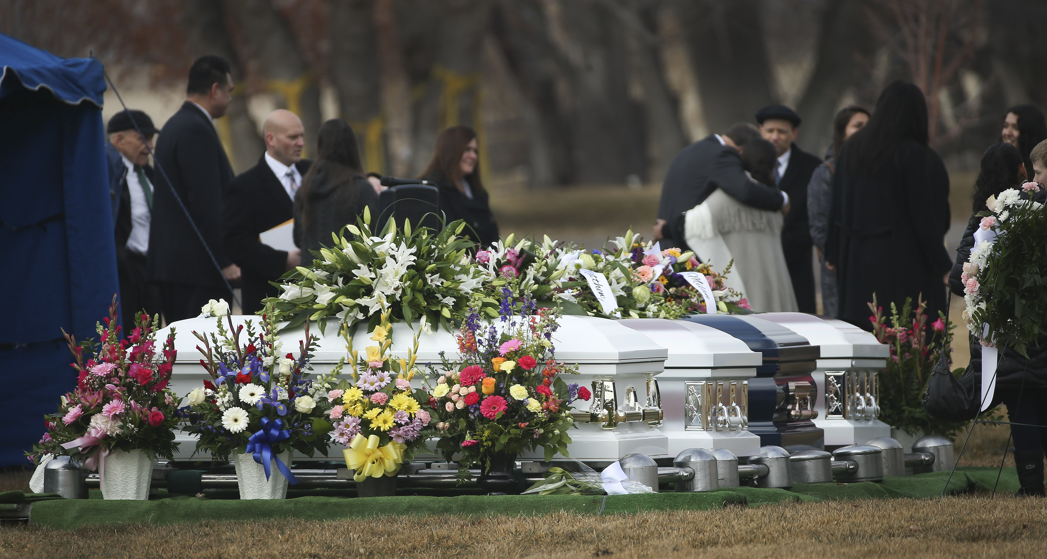 Family members gather at the Grantsville City Cemetery following the funeral for Alejandra Haynie and three of her children — Alexis, Matthew and Milan — in Grantsville onon Friday, Jan. 24, 2020.
