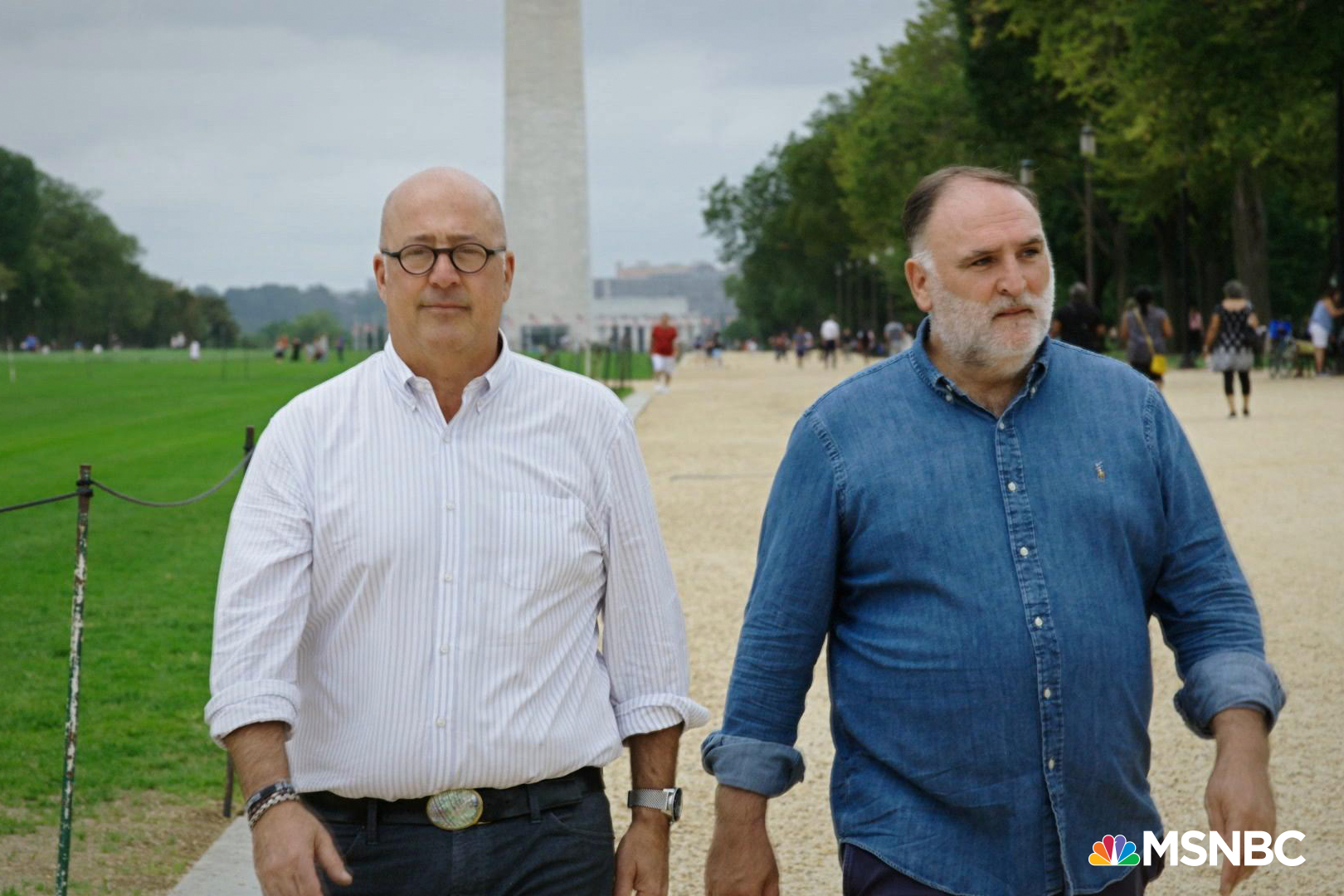 Andrew Zimmern and José Andrés walking, with the Washington Monument in the background.