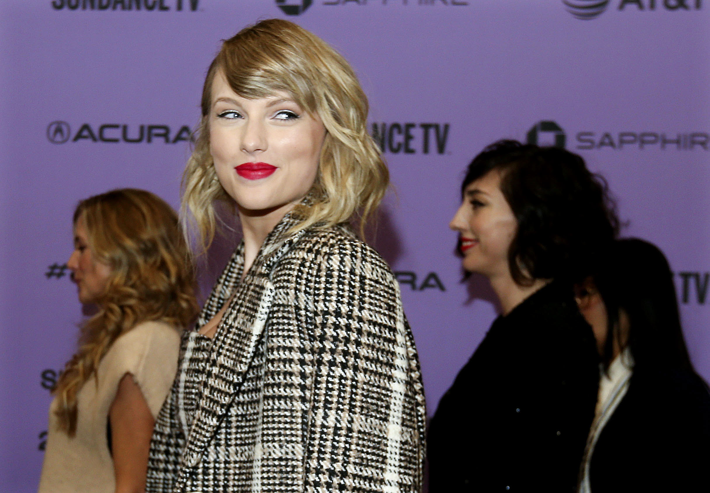 """Taylor Swift poses for photos before the premiere of the documentary """"Miss Americana"""" at the Eccles Theatre in Park City, Thursday, Jan. 23, 2020."""