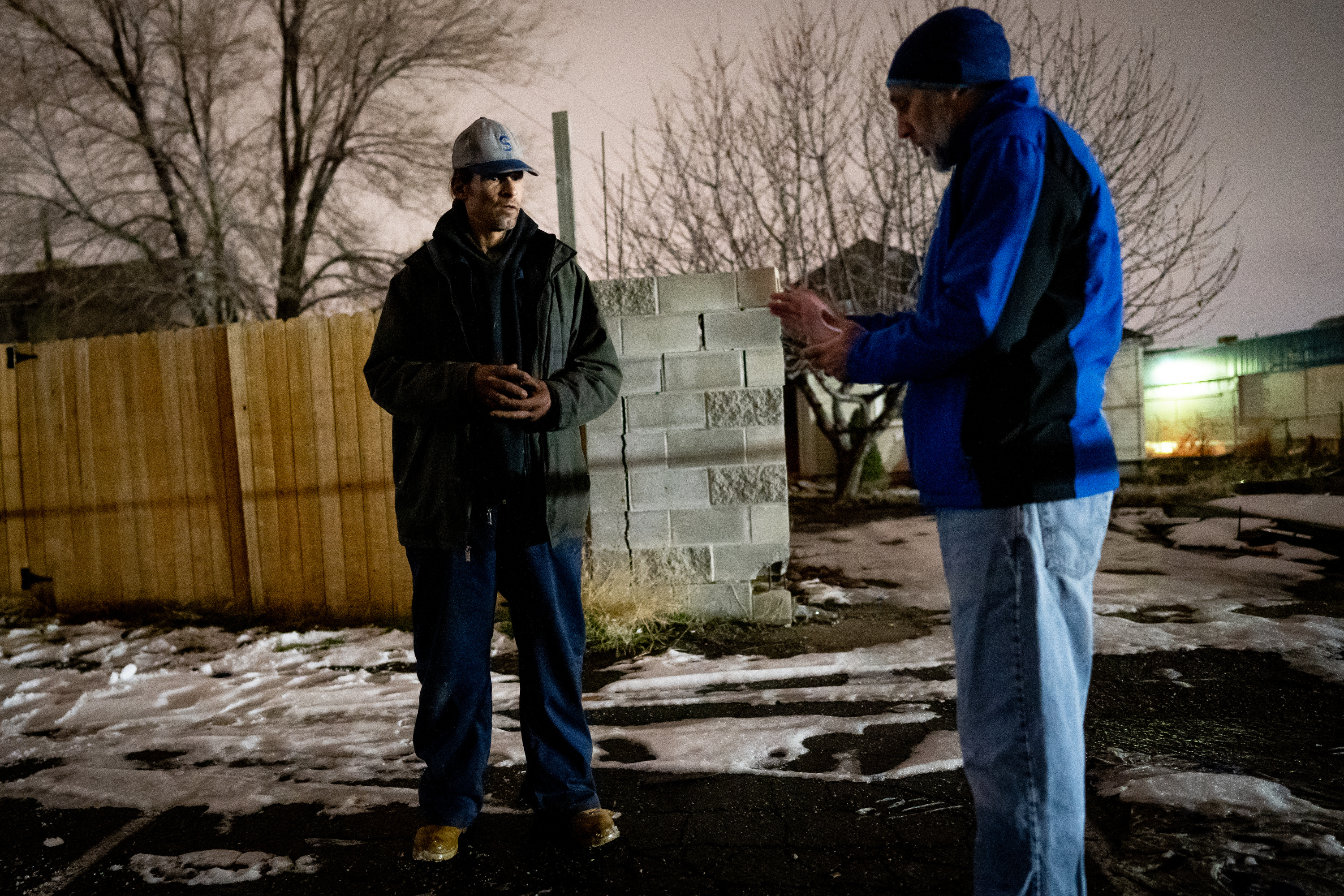 David Litvack, senior policy adviser to Salt Lake City Mayor Erin Mendenhall, right, interviews Jeremy, left, behind a business onNorth Temple while volunteering for the annual Point-in-Time count in Salt Lake City on Thursday, Jan. 23, 2020. Point-in-Time is a count of sheltered and unsheltered people experiencing homelessness conducted nationwide over several days in January.